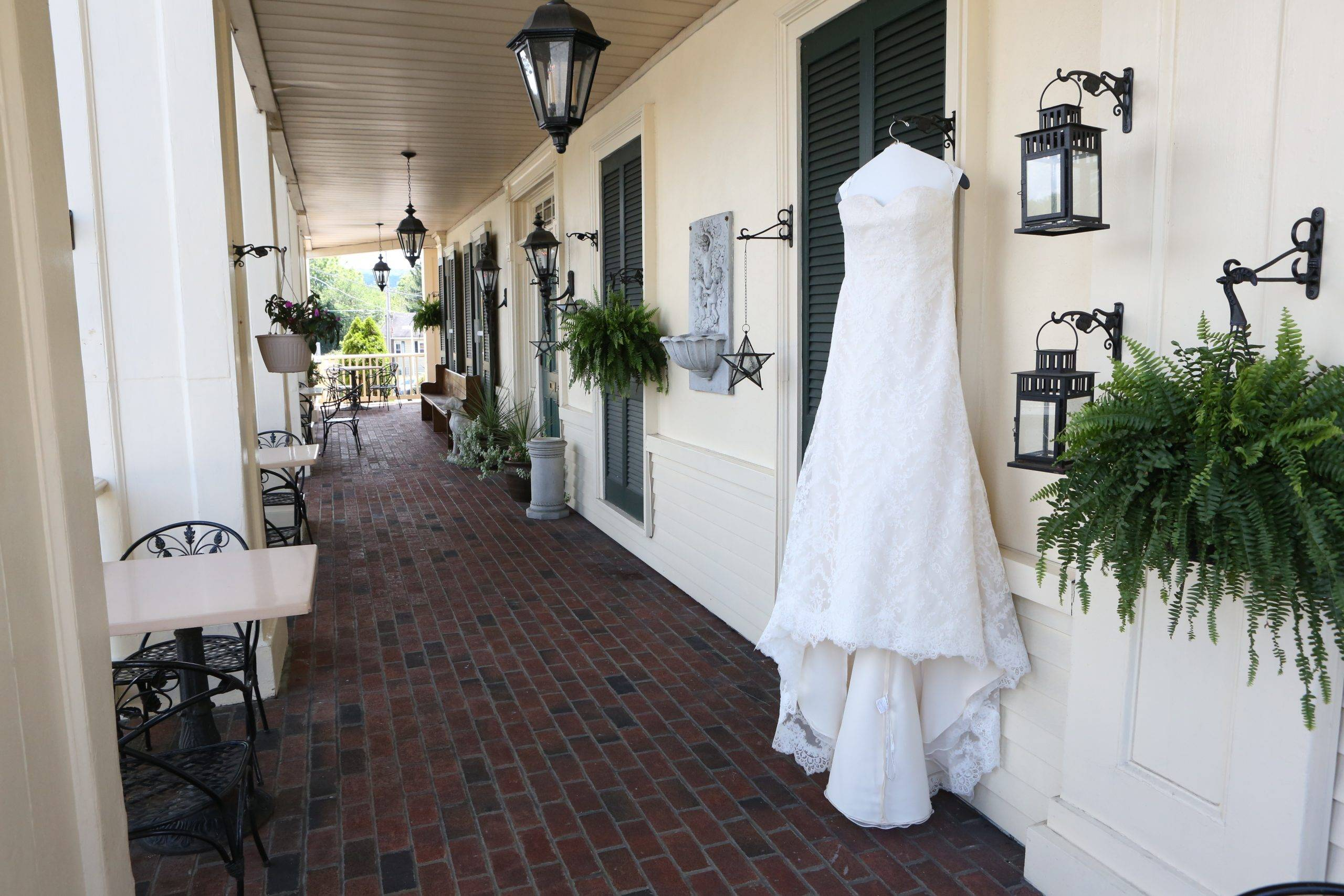 David's Country Inn wedding dress on front porch