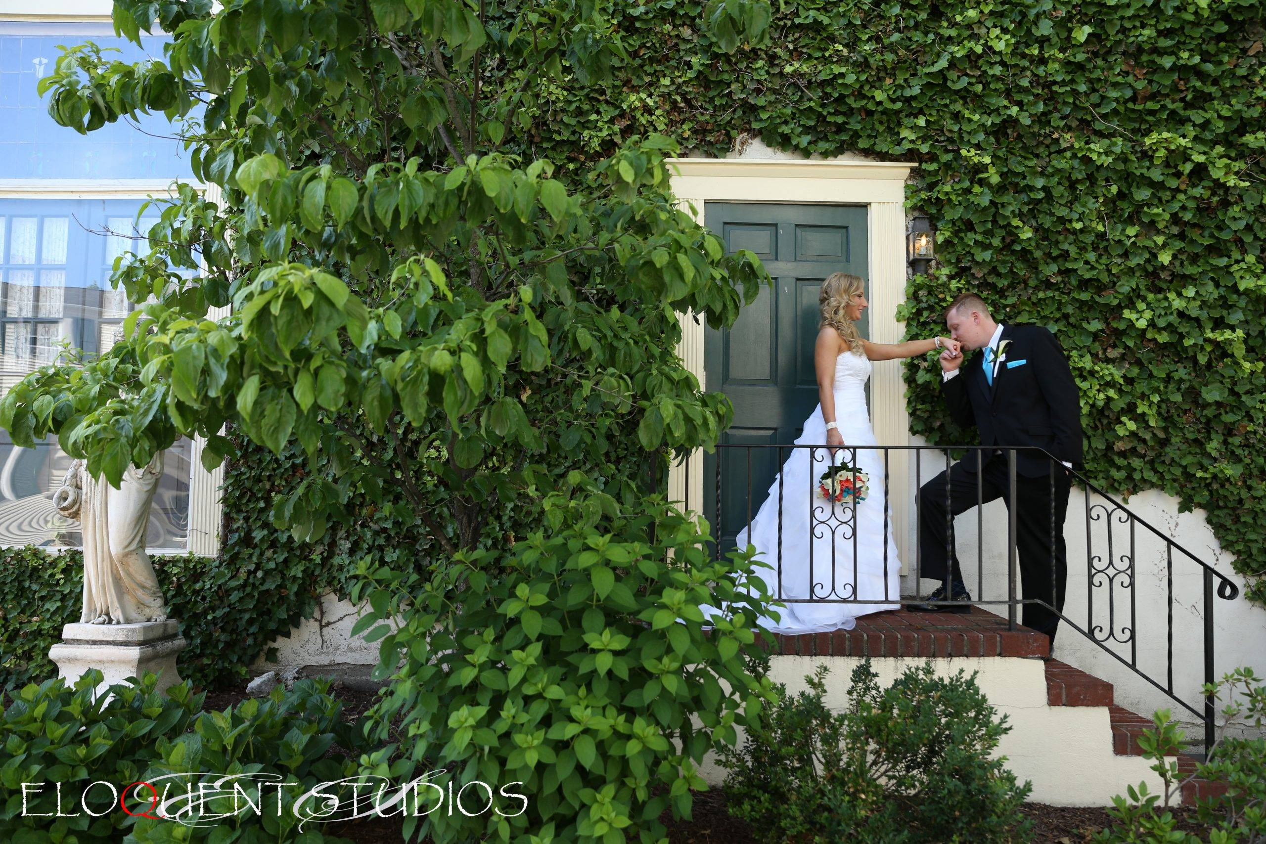 David's Country Inn kissing the bride's hand at the door