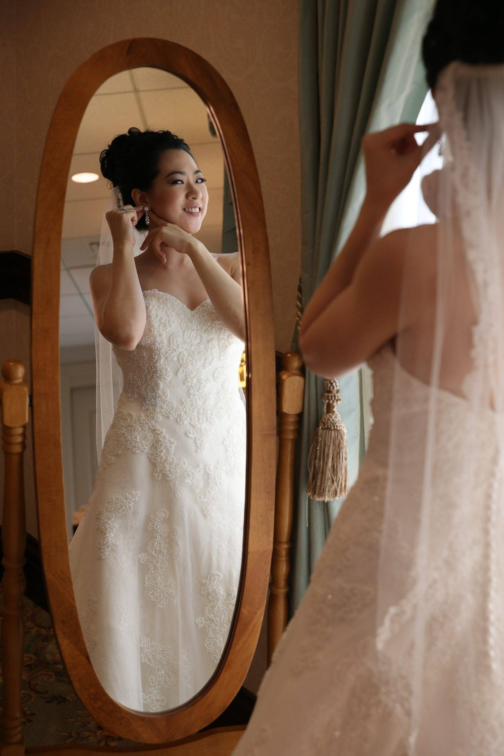 Brooklake bride getting ready in mirror