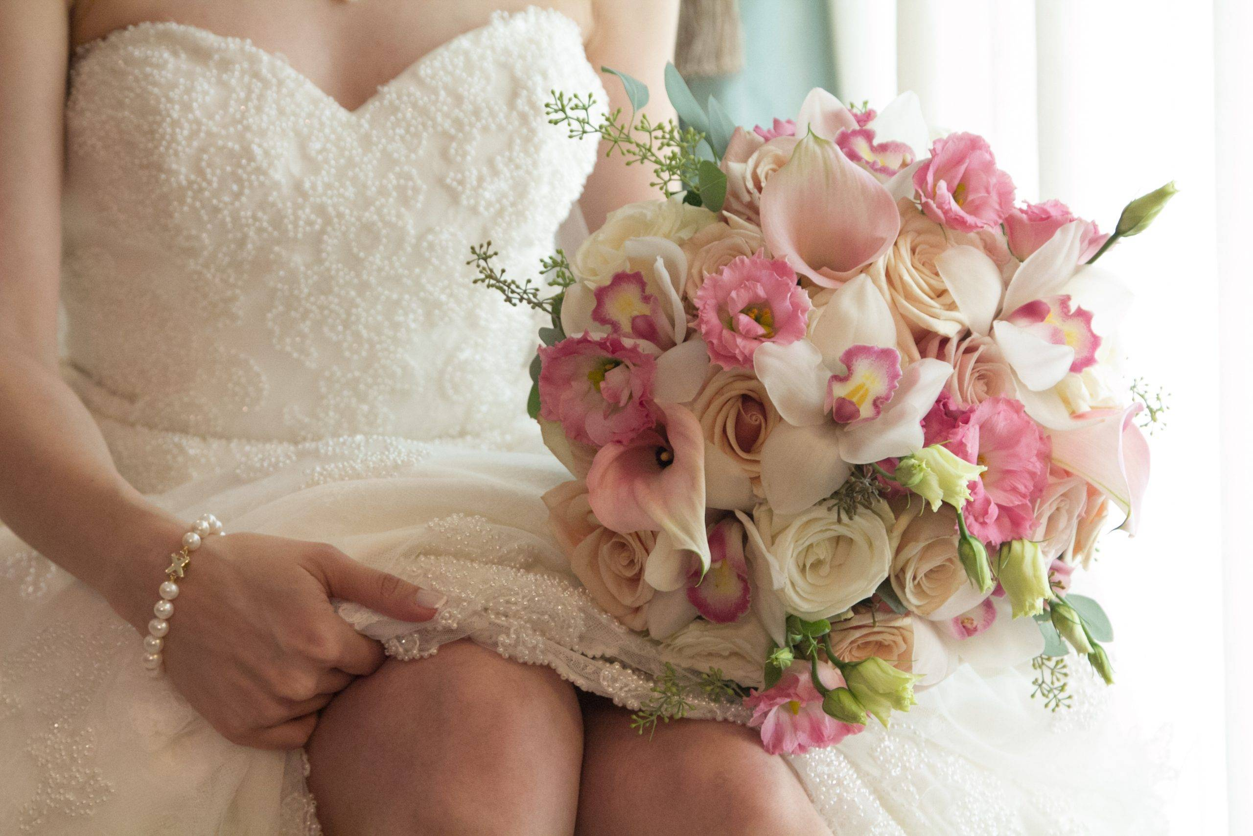 Brooklake seated bride with bouquet