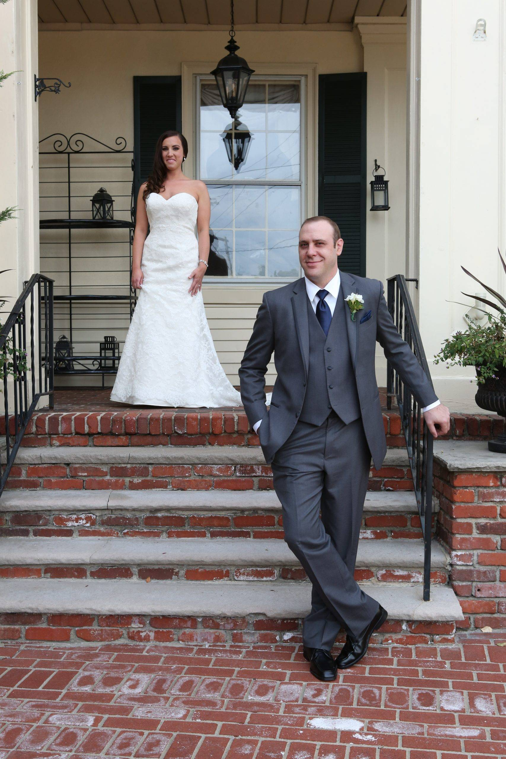 David's Country Inn bride and groom on front porch steps