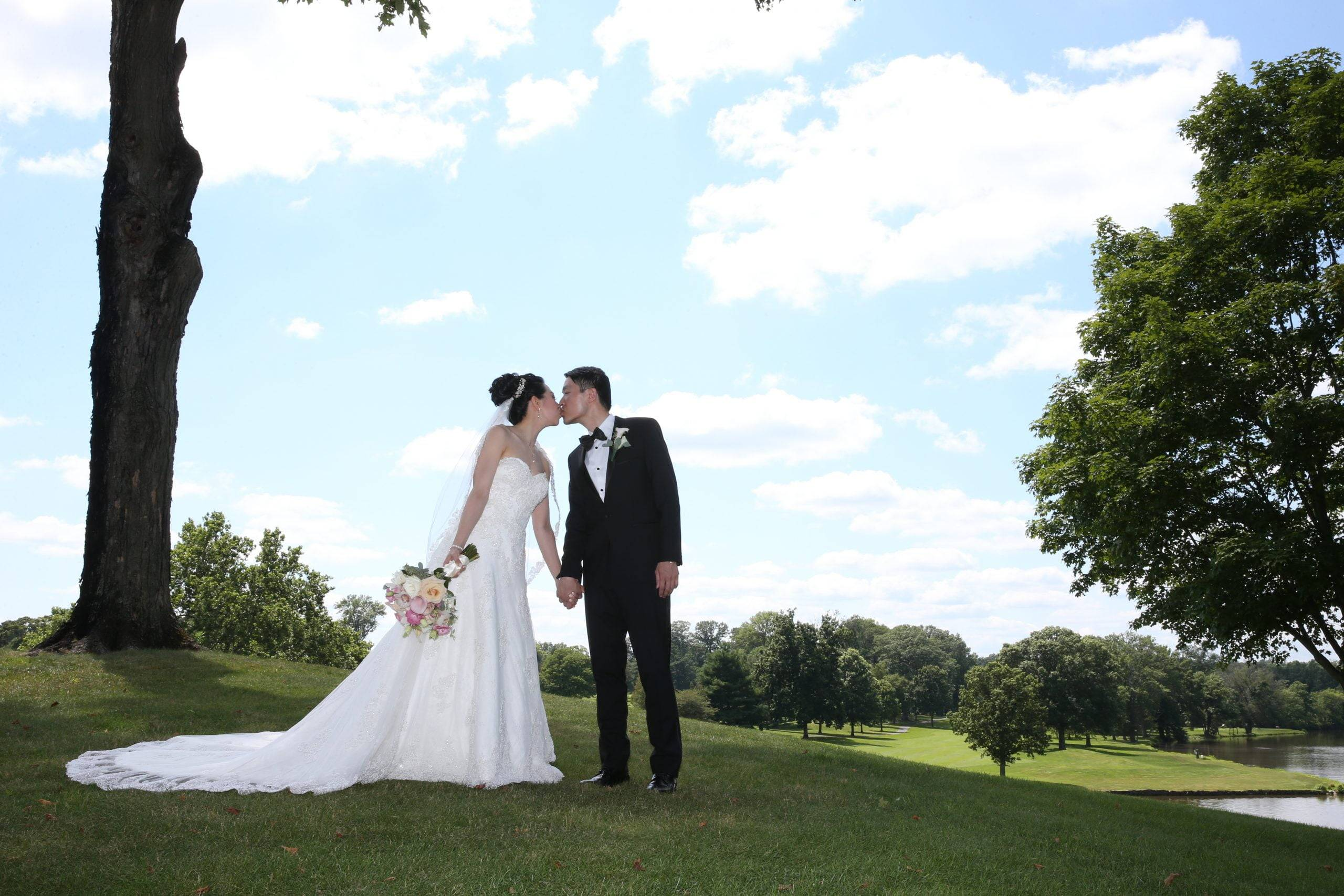 Brooklake bride and groom kiss on the lawn