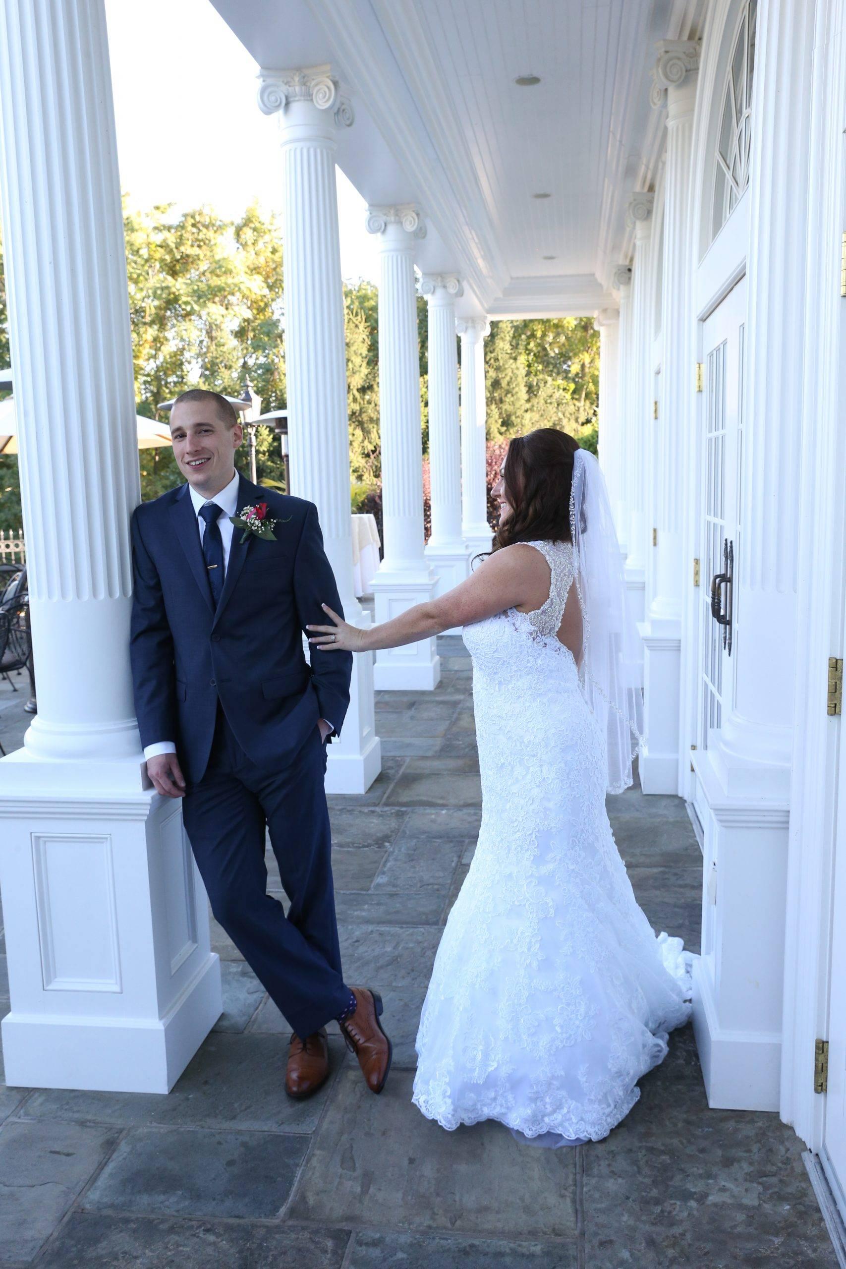 Park Savoy bride approaching groom