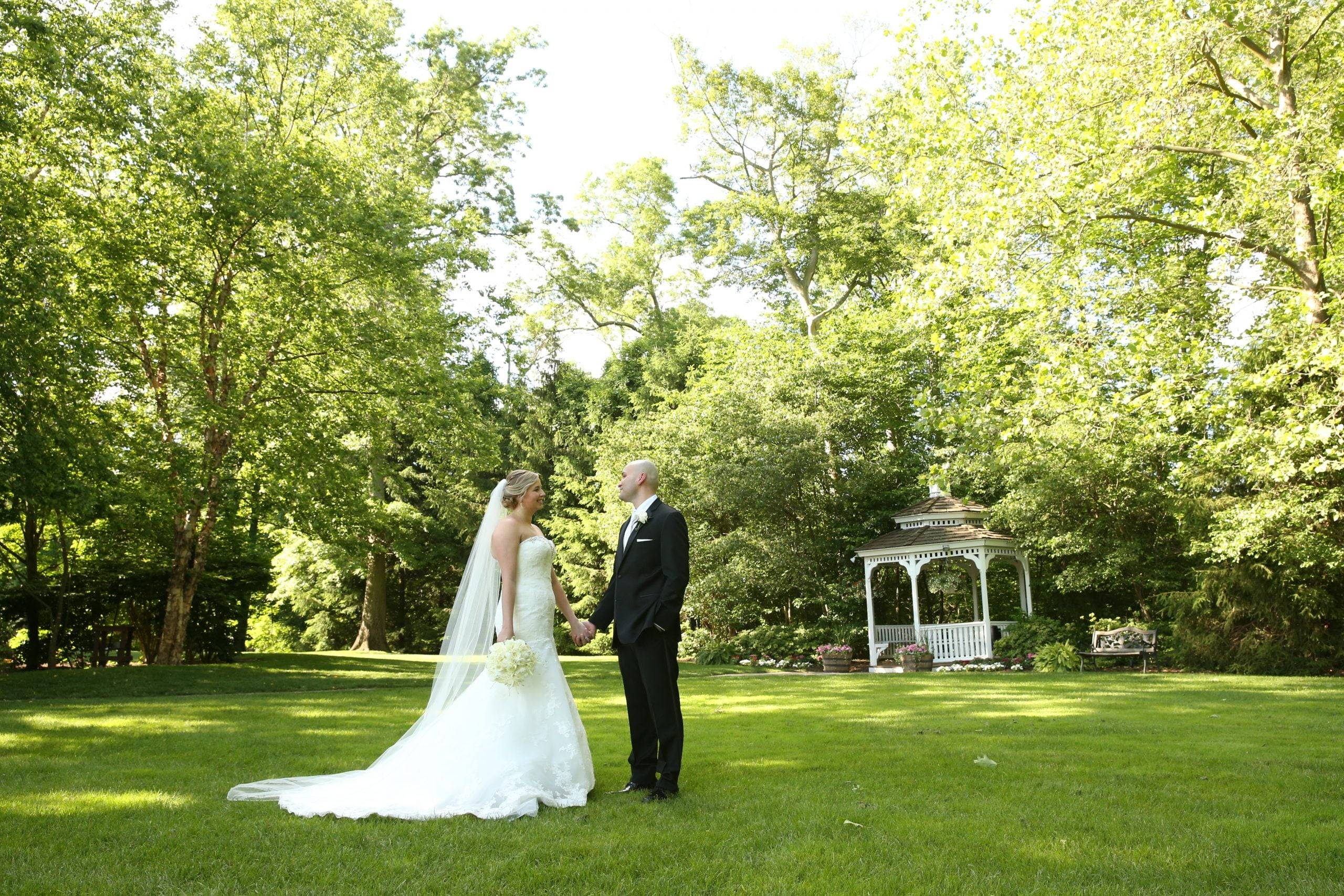 Olde Mill Inn bride and groom in the gardens