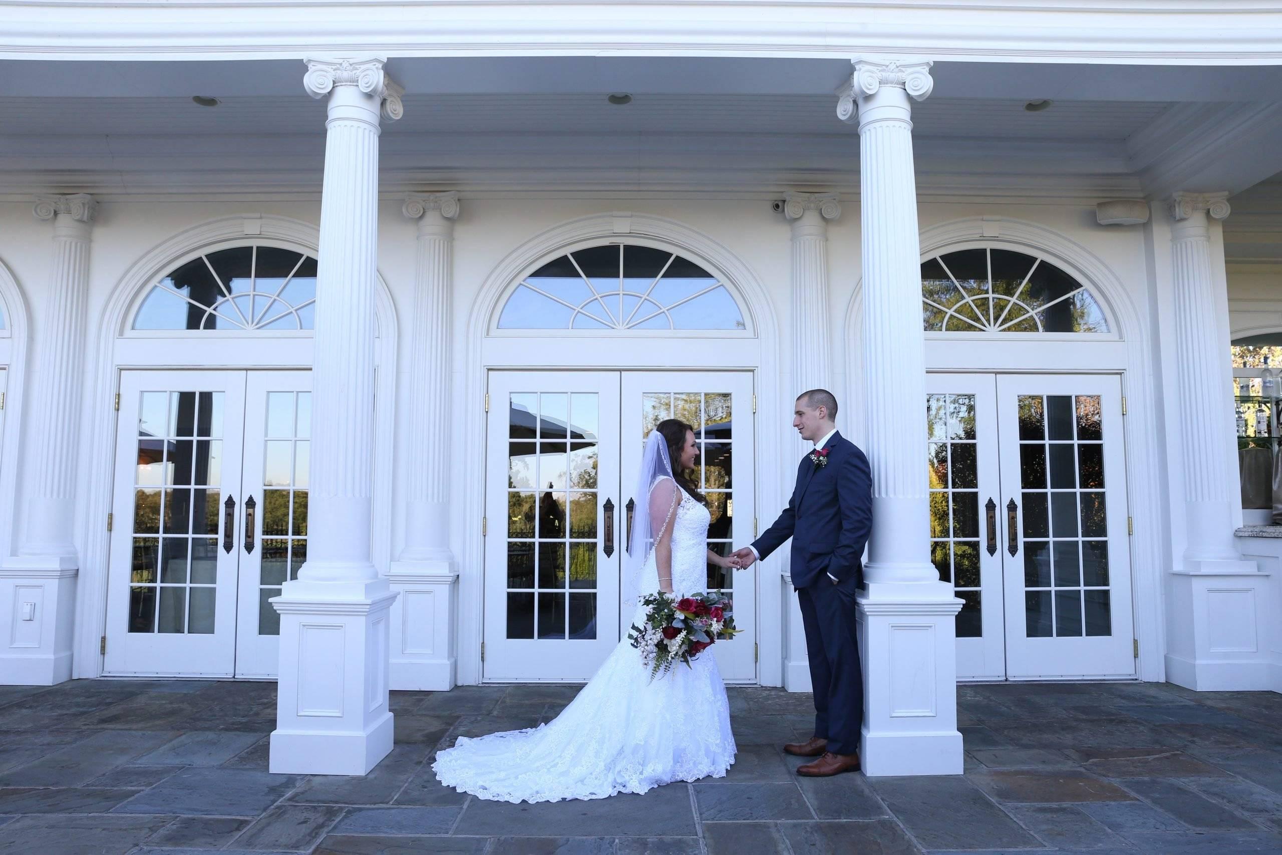 Park Savoy bride and groom on patio