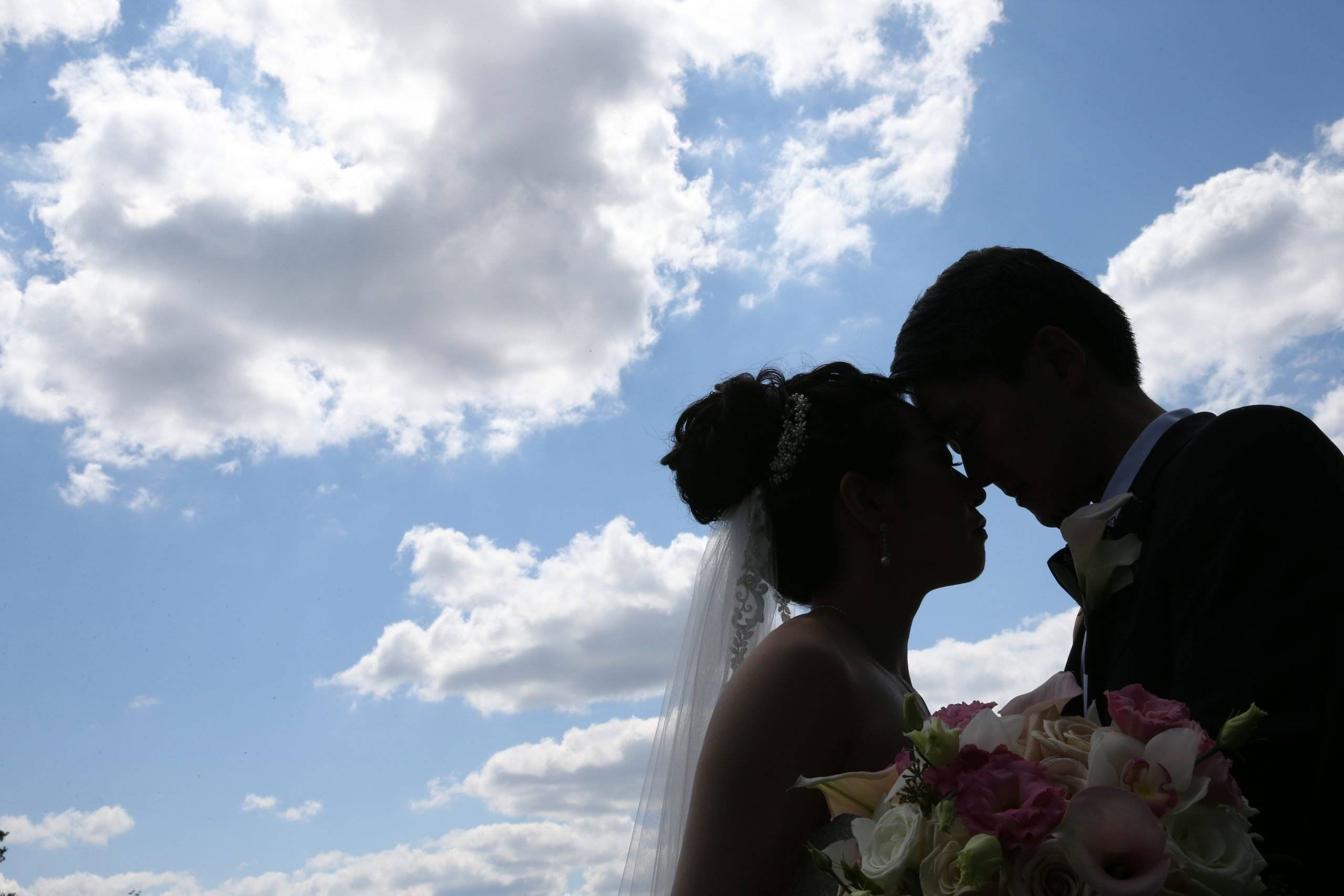 Brooklake bride and groom with the blue sky