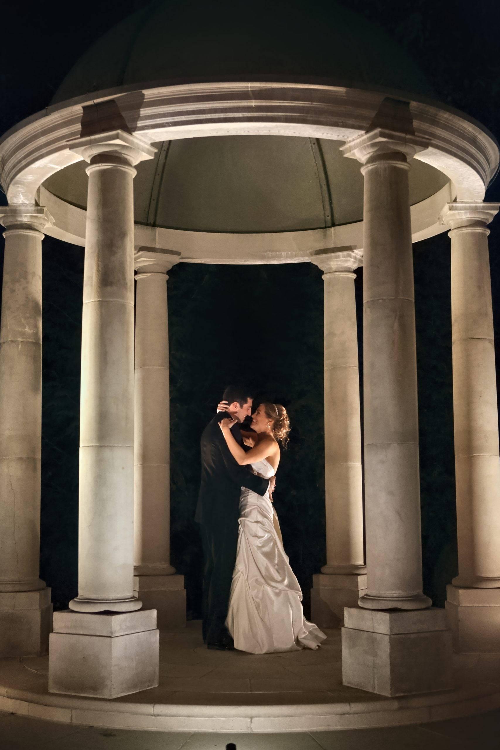 Florentine Gardens bride and groom in stone gazebo