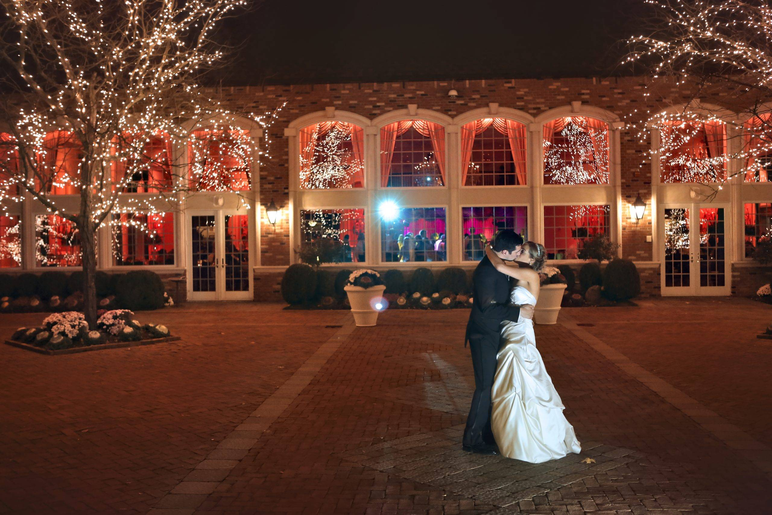 Florentine Gardens bride and groom kissing on patio