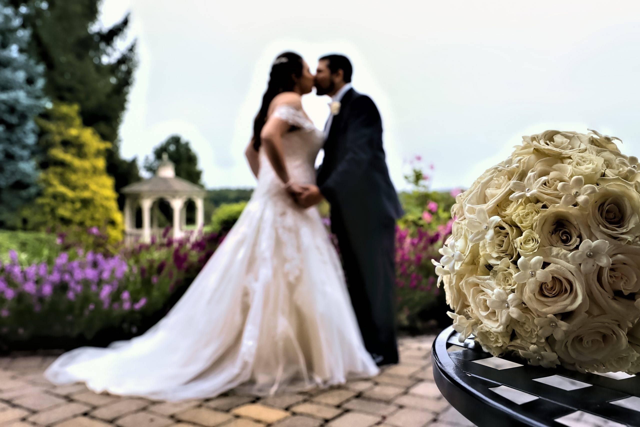 Basking Ridge CC bride and groom on patio