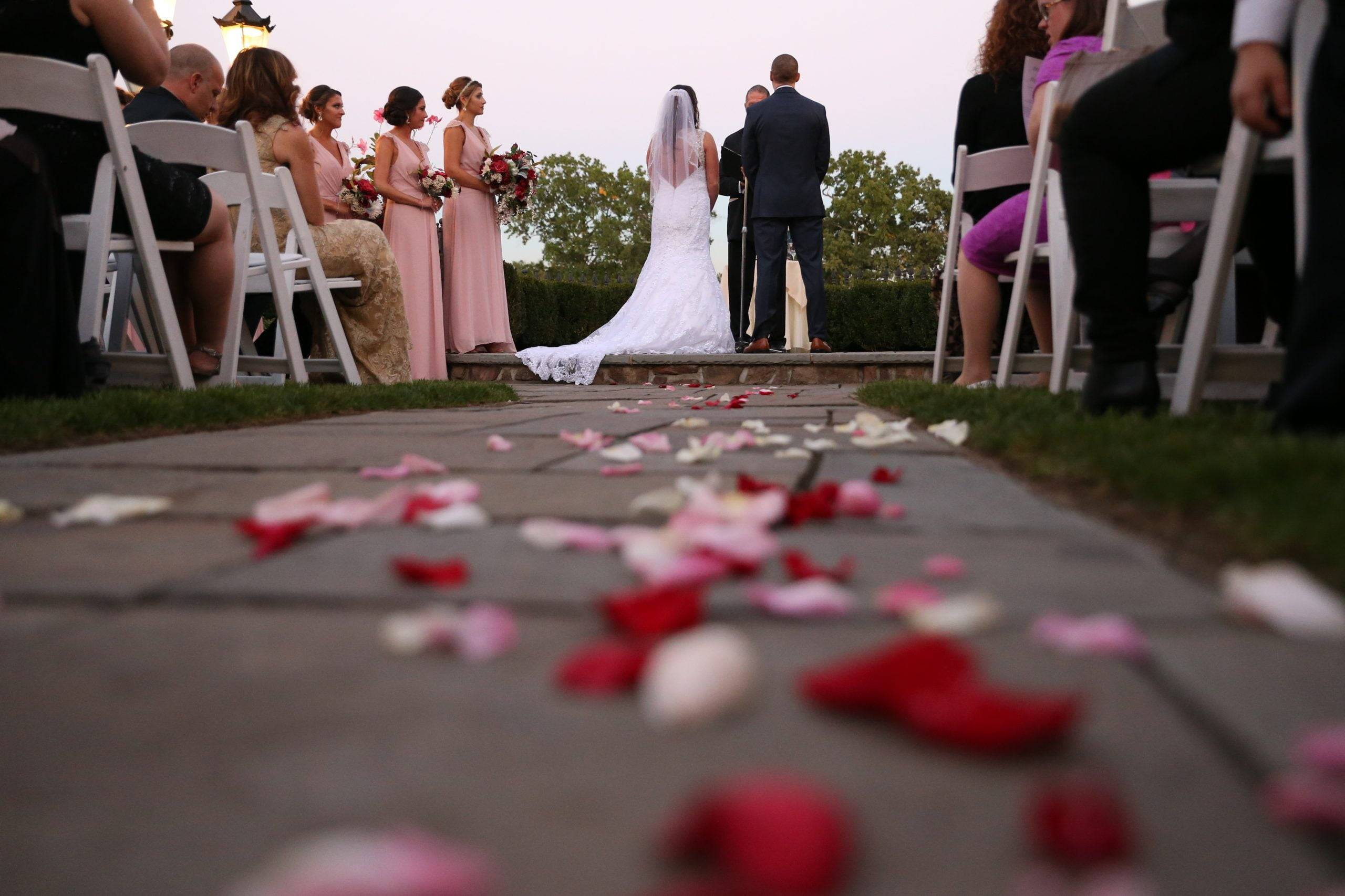 Park Savoy bride and groom with flower petals on the aisle