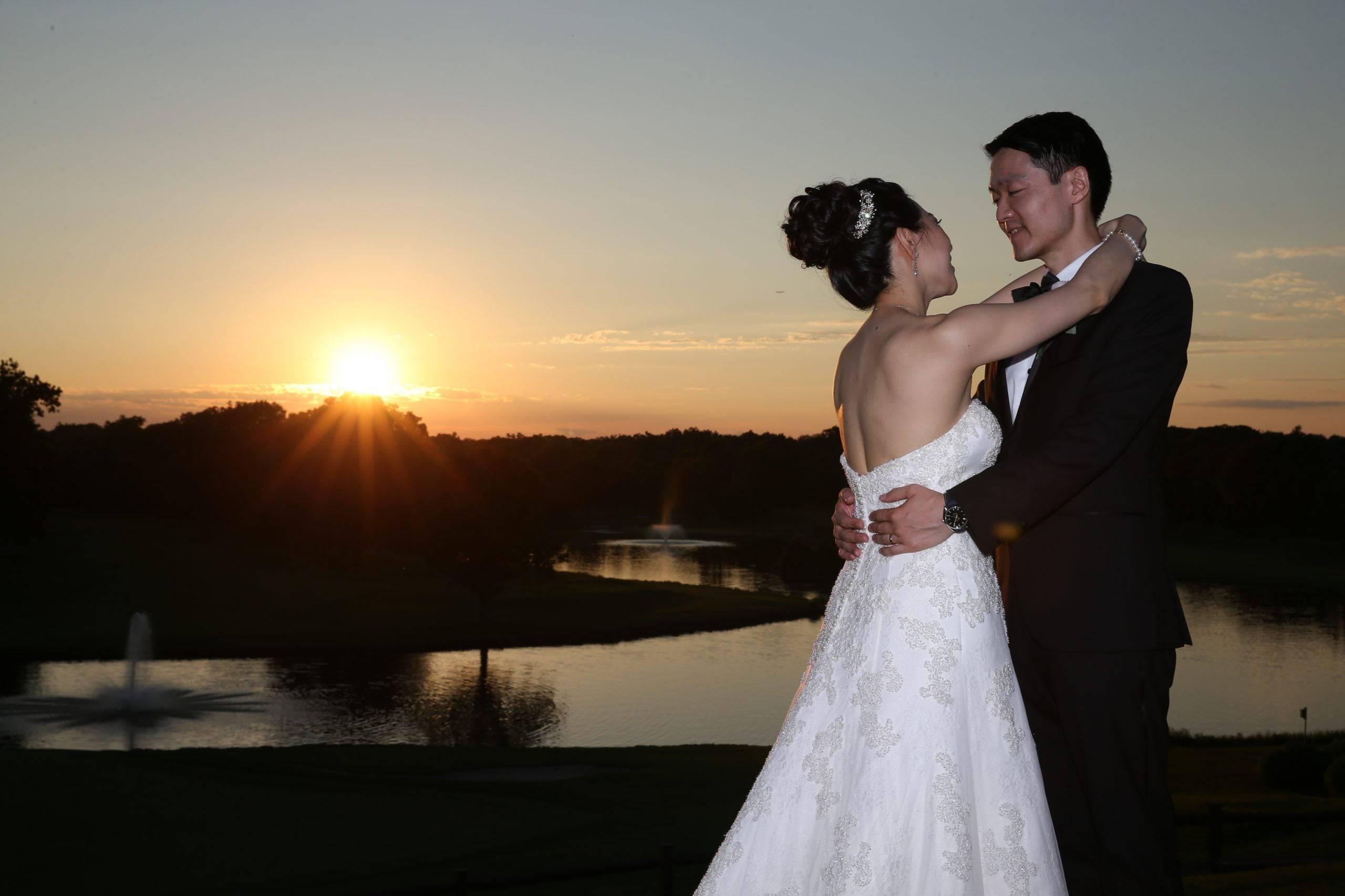 Brooklake wedding couple with sunset over lake