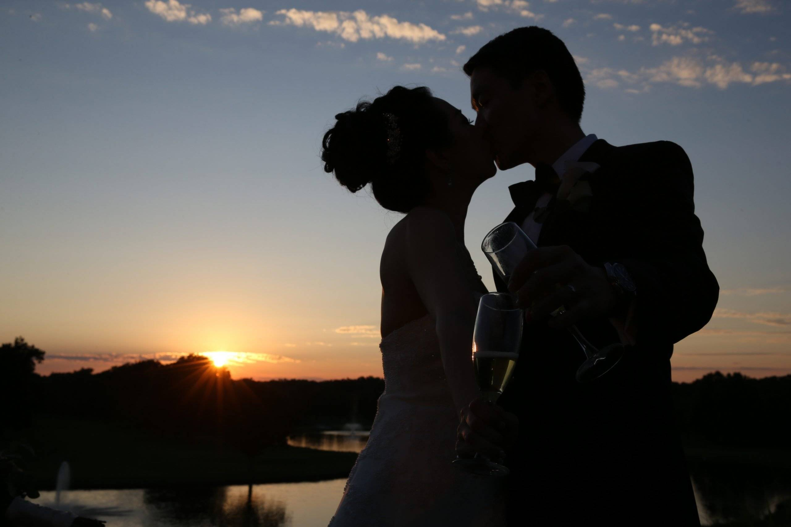 Brooklake wedding kiss with sunset by the lake
