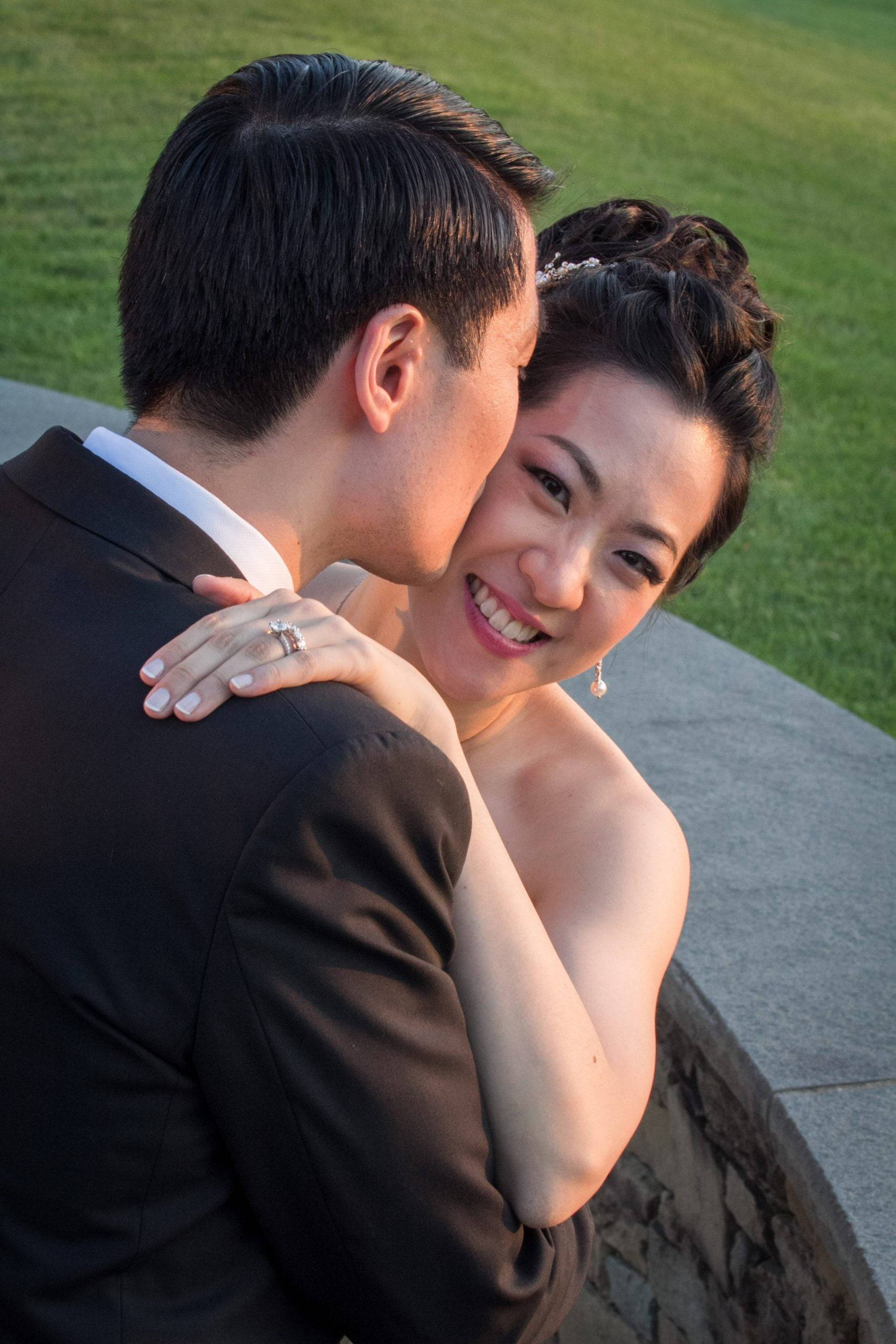 Brooklake smiling bride gets a kiss from groom