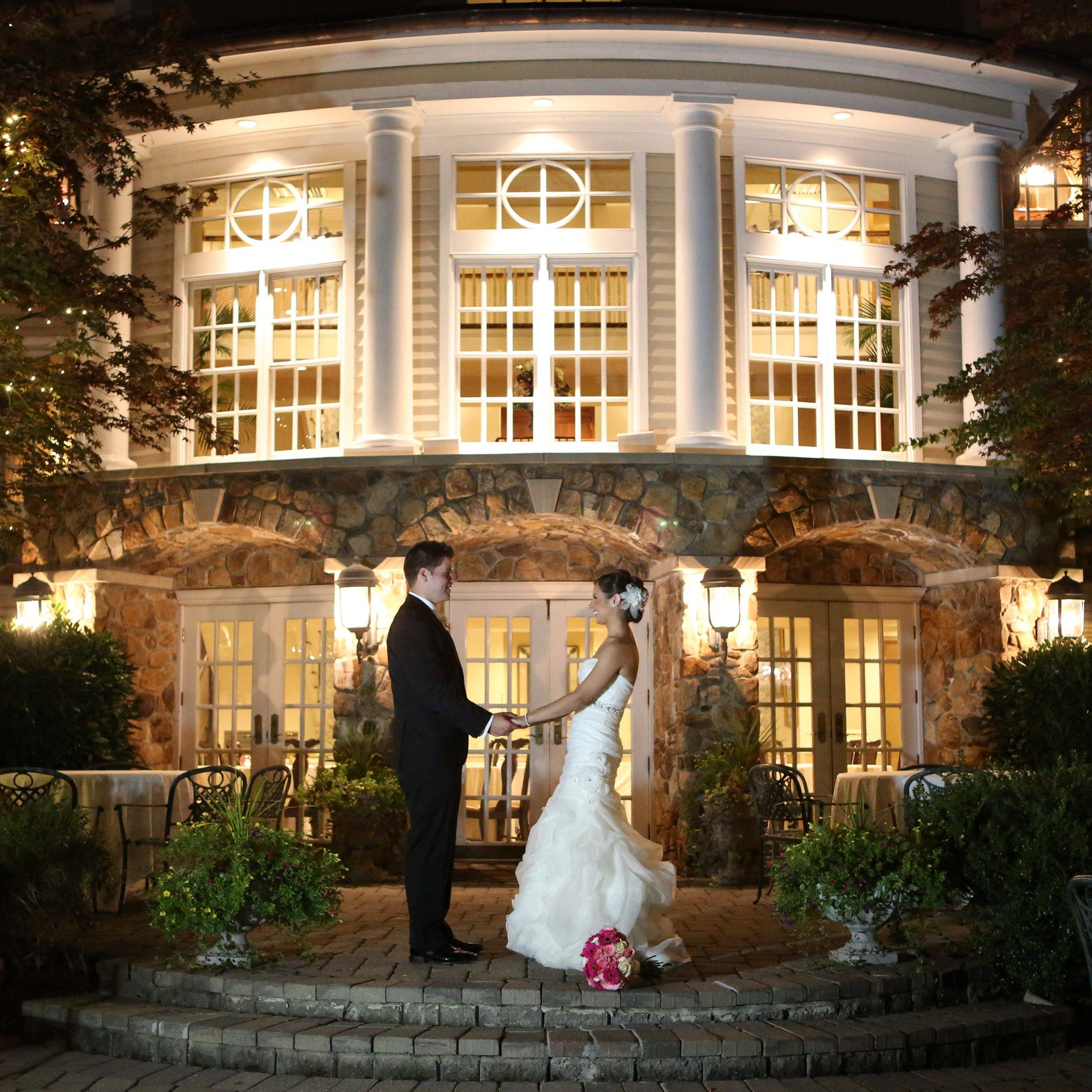 Olde Mill Inn bride and groom outside at night