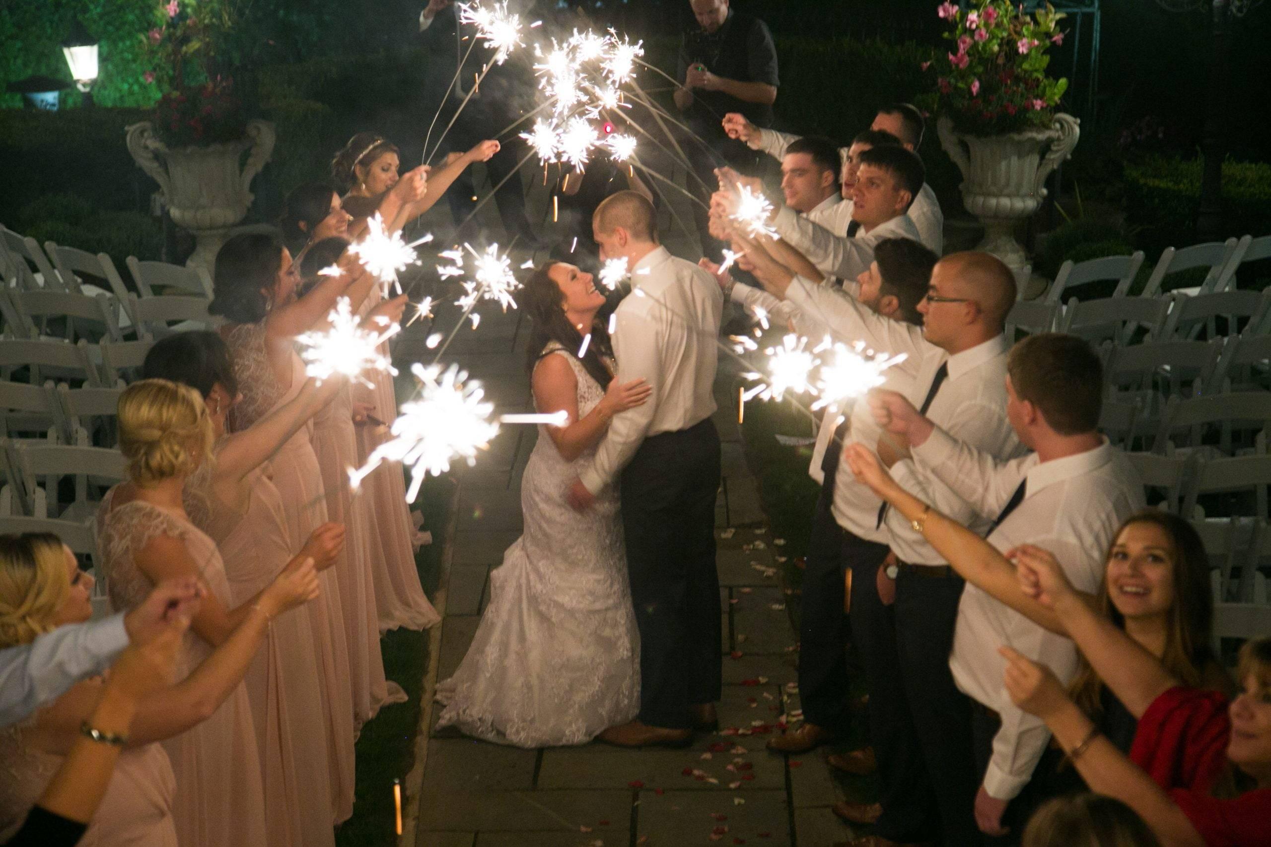 Park Savoy bride and groom kiss under sparklers