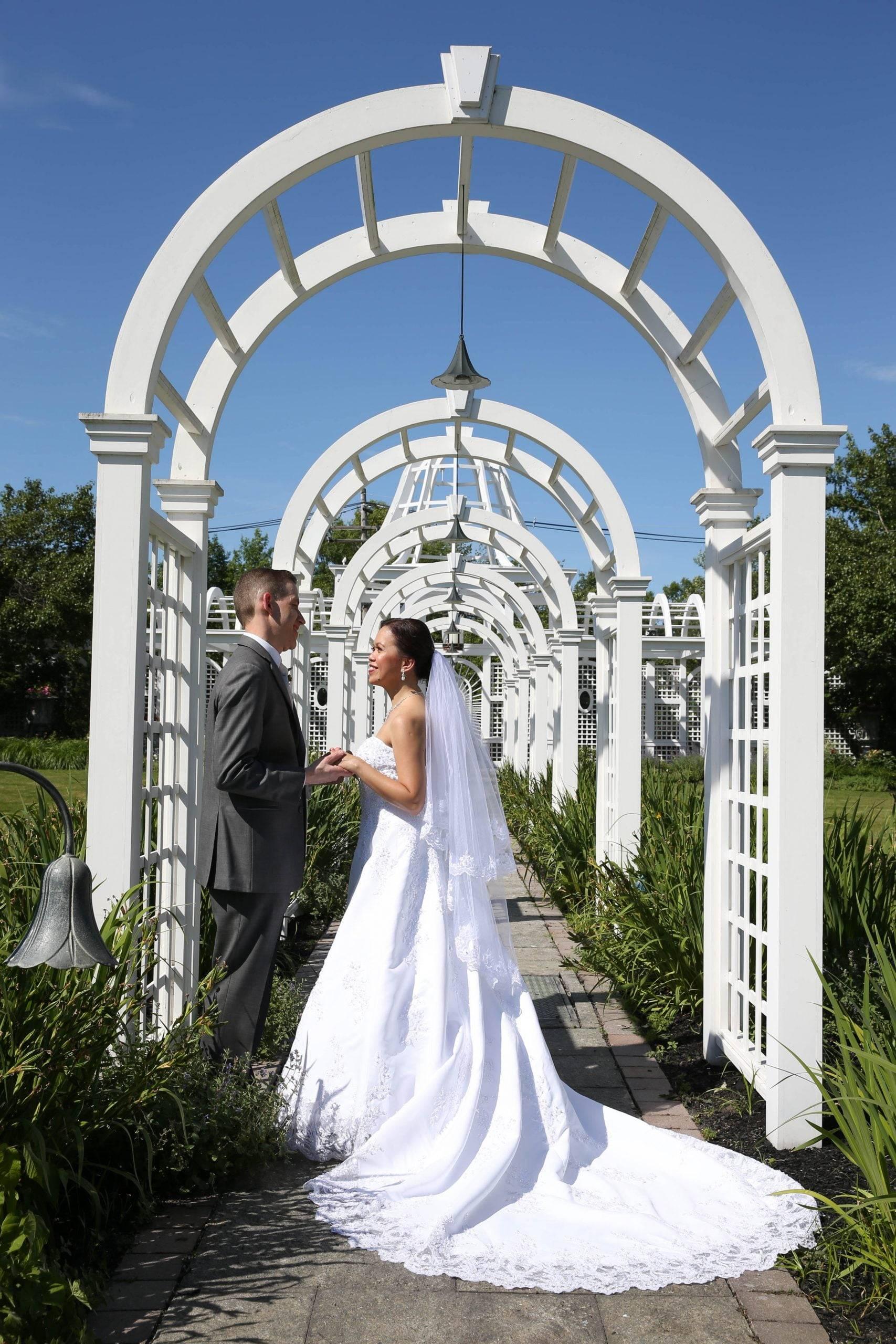 Birchwood Manor bride and groom by arbor