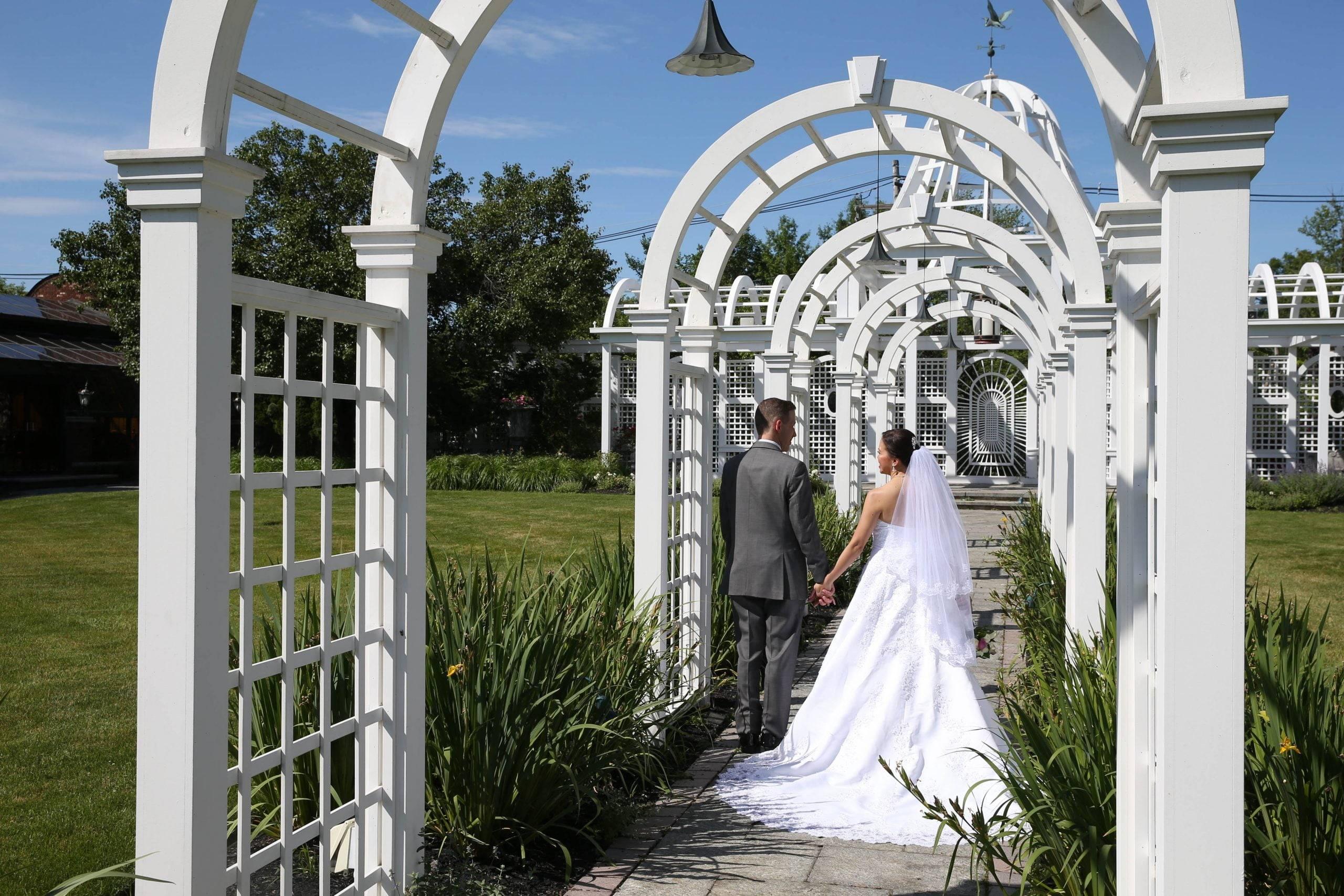 Birchwood Manor bride and groom in arbor