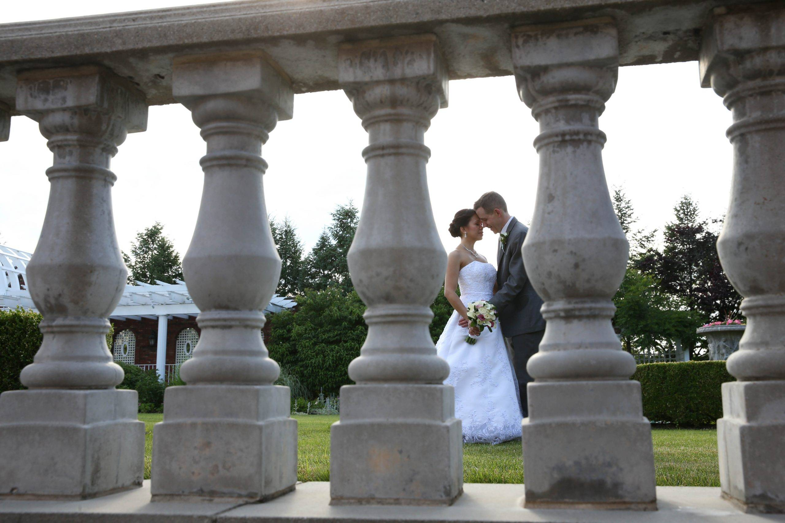 Birchwood Manor bride and groom through railing