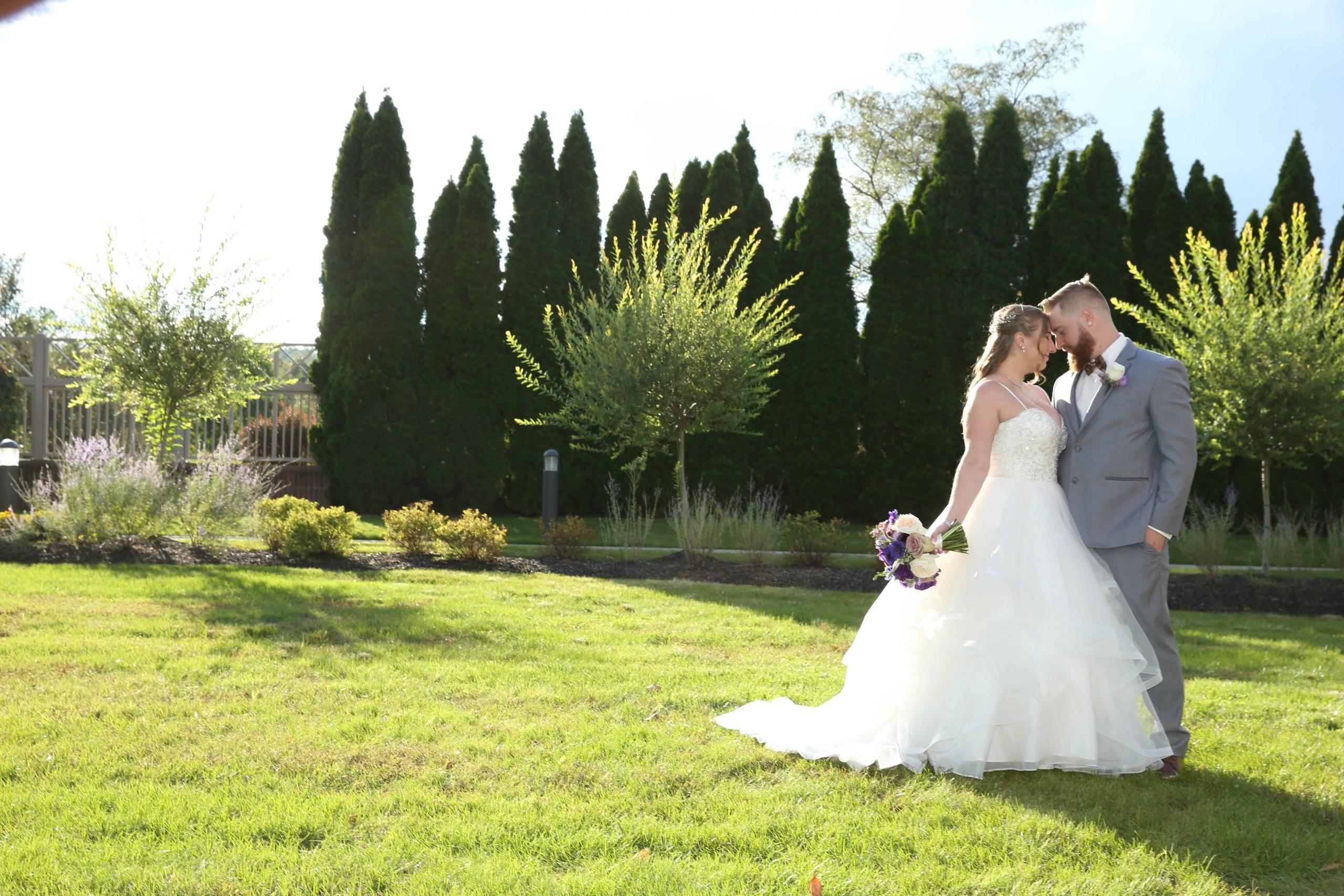Primavera Regency bride and groom outside