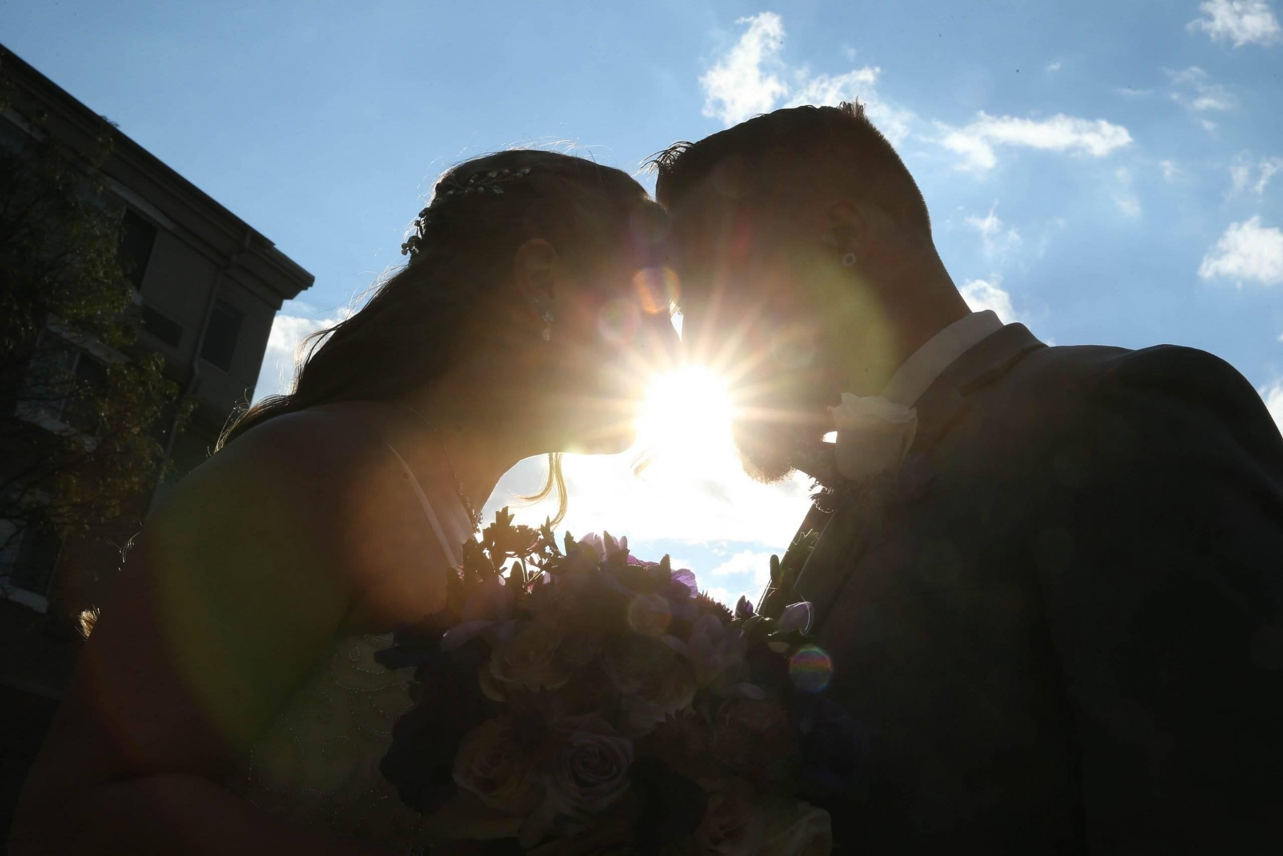 Primavera Regency wedding couple with the sun peaking through their profiles