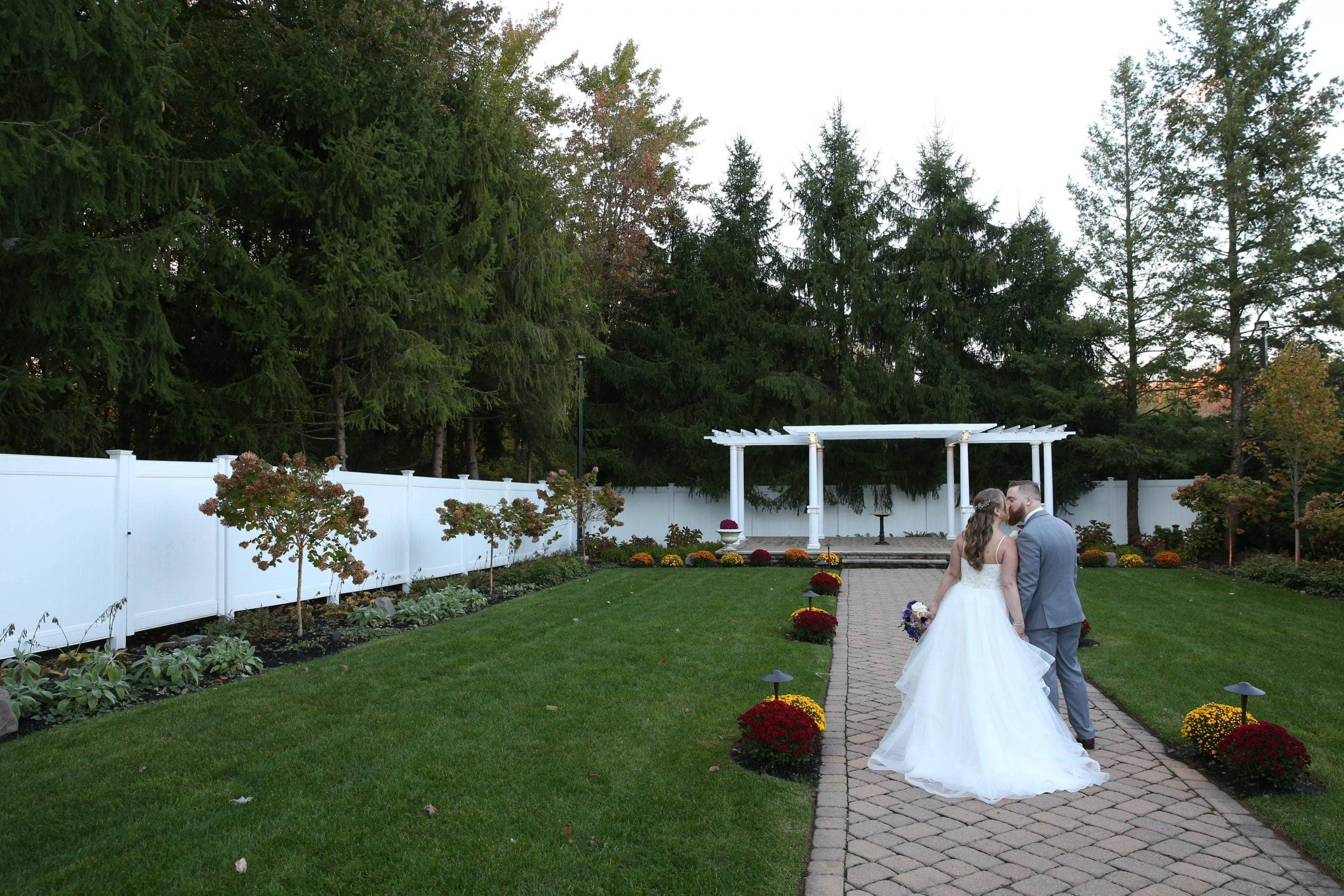 Primavera Regency bride and groom in the garden