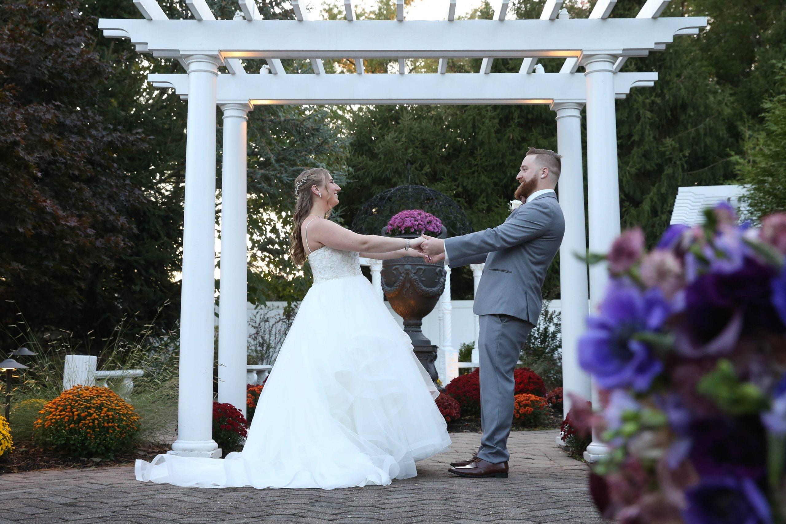 Primavera Regency bride and groom under the arbor