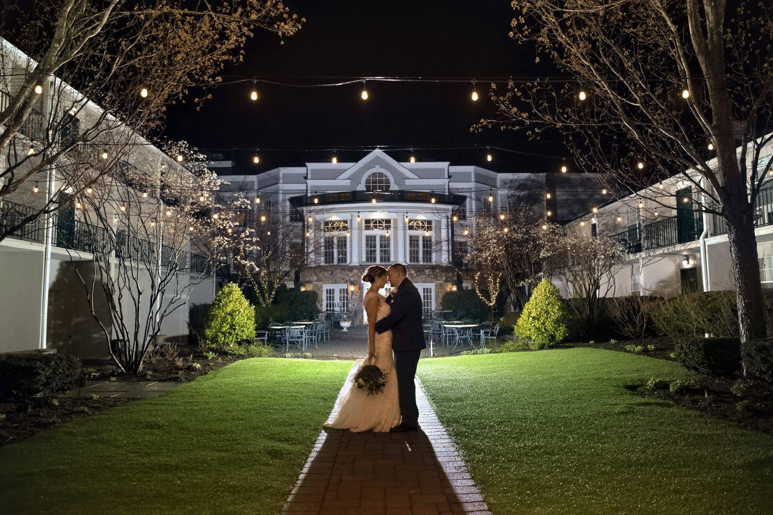 Olde Mill Inn wedding couple in courtyard at night