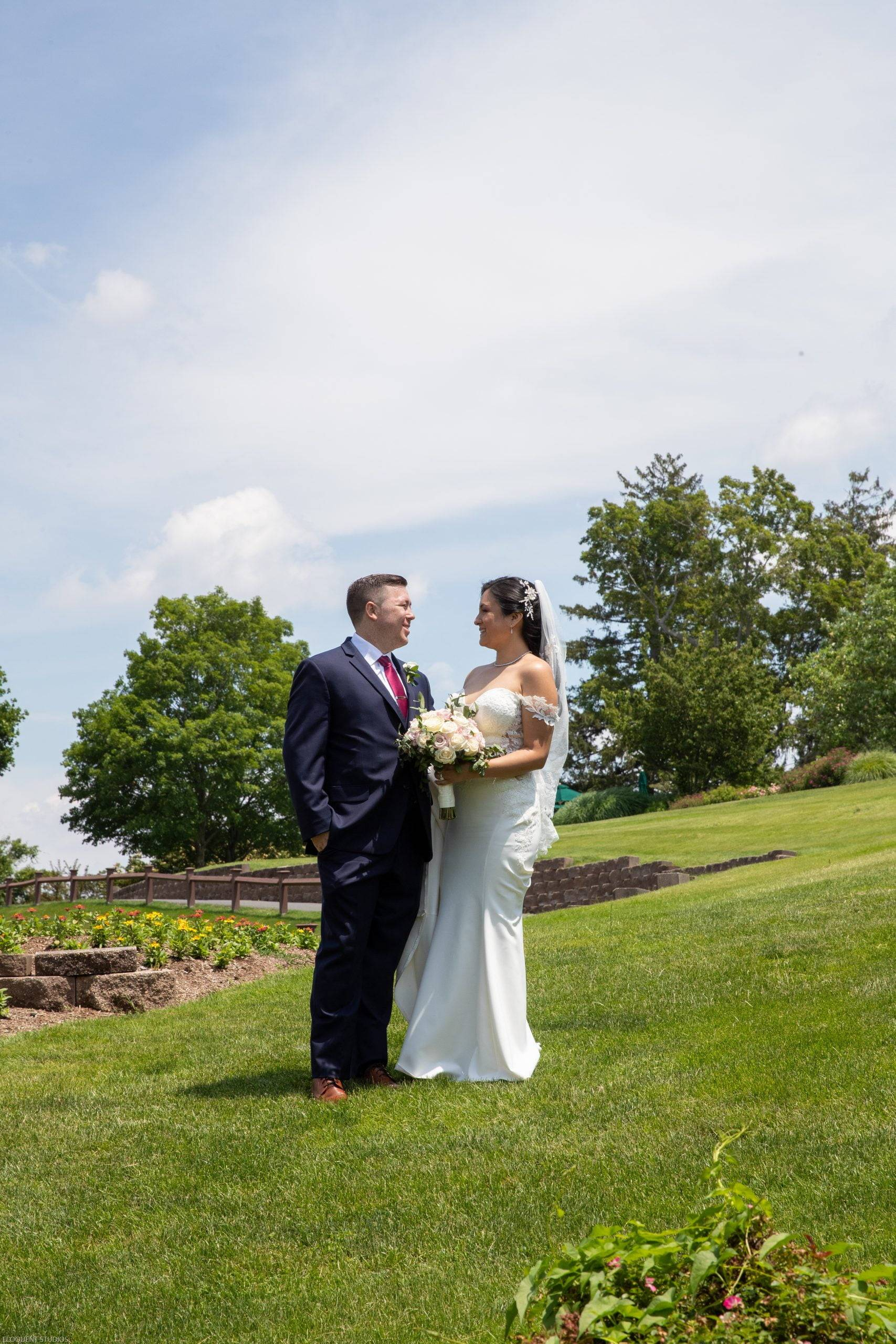 Brooklake bride and groom on the grassy hill