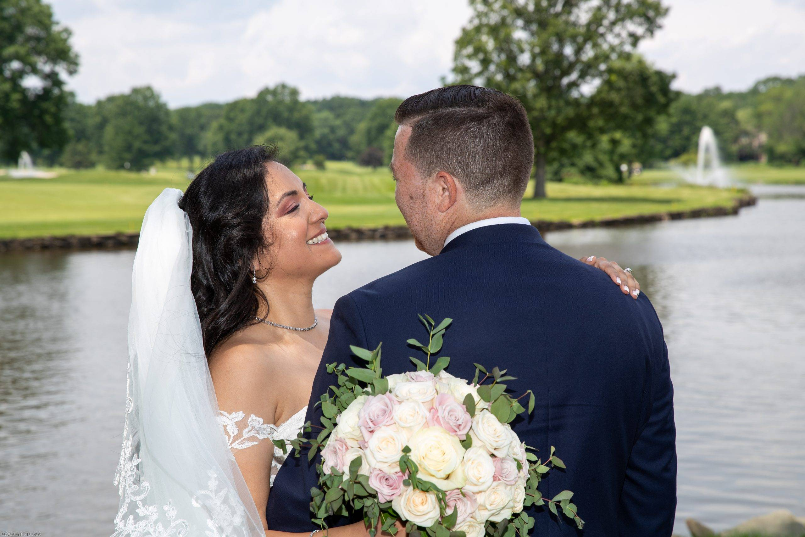 Brooklake bride and groom laughing by the lake