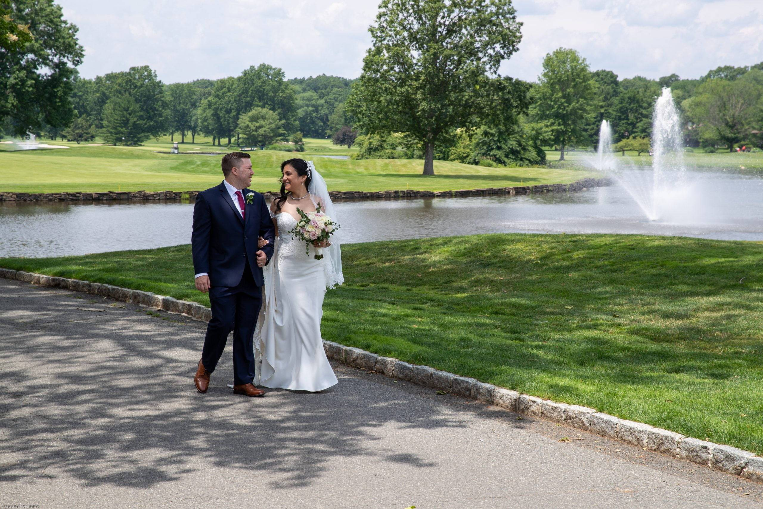 Brooklake bride and groom walking by the lake