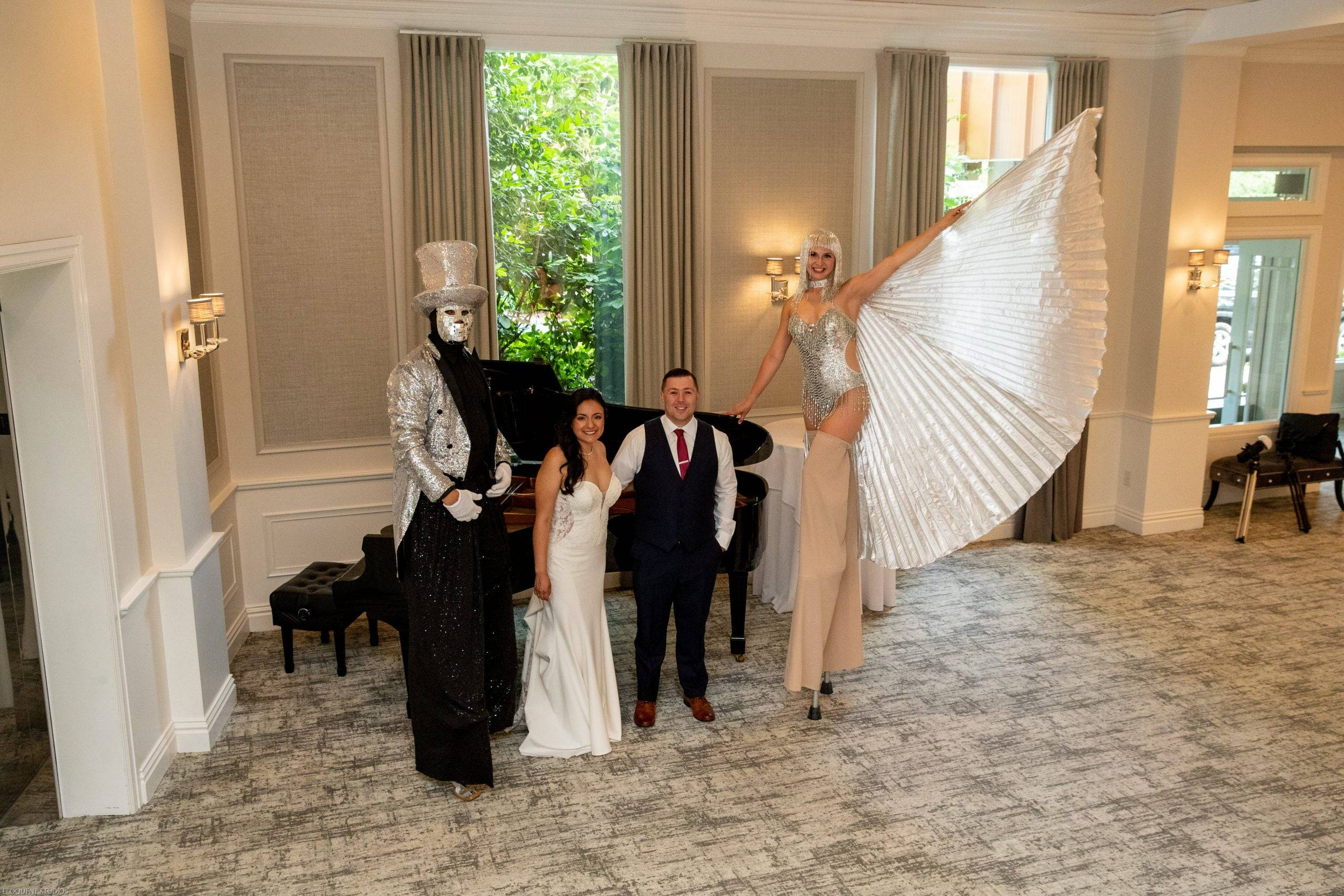 Brooklake bride and groom with stilt walkers