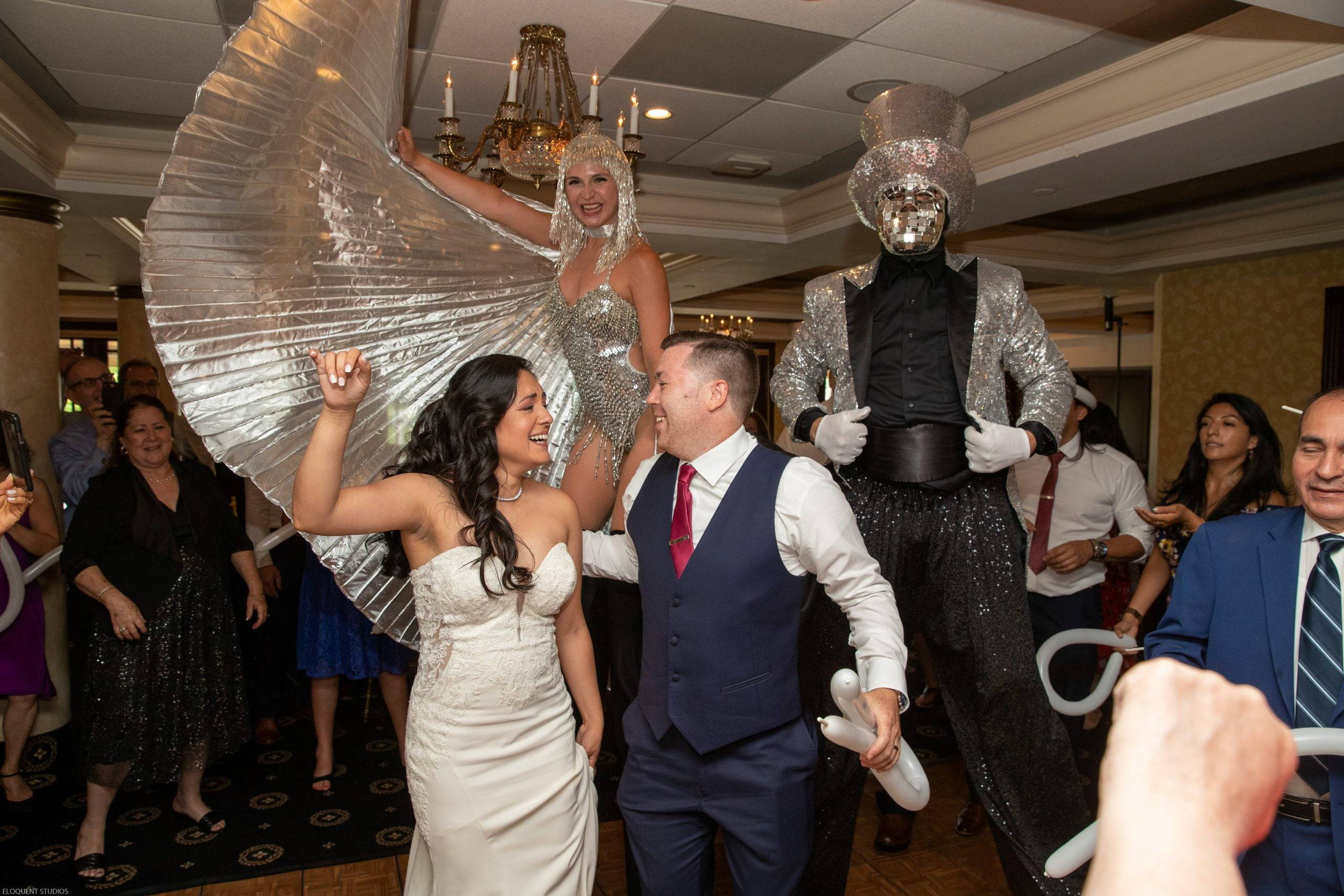 Brooklake bride and groom on dance floor with stilt walkers