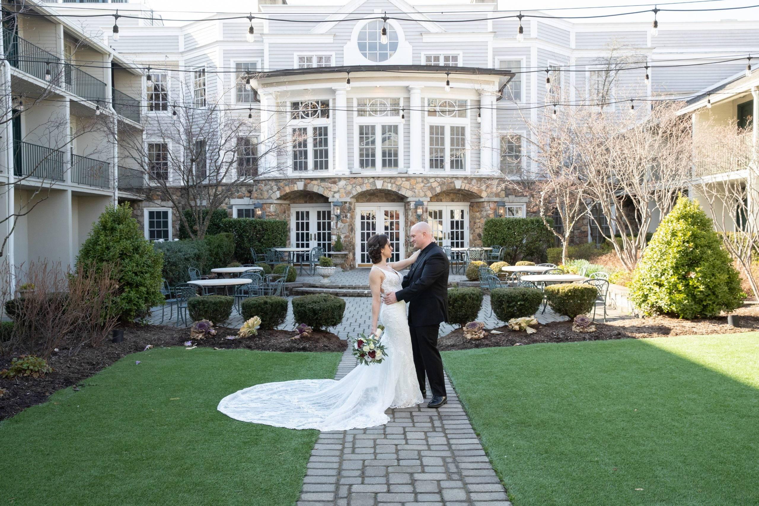 Olde Mill Inn bride and groom in courtyard
