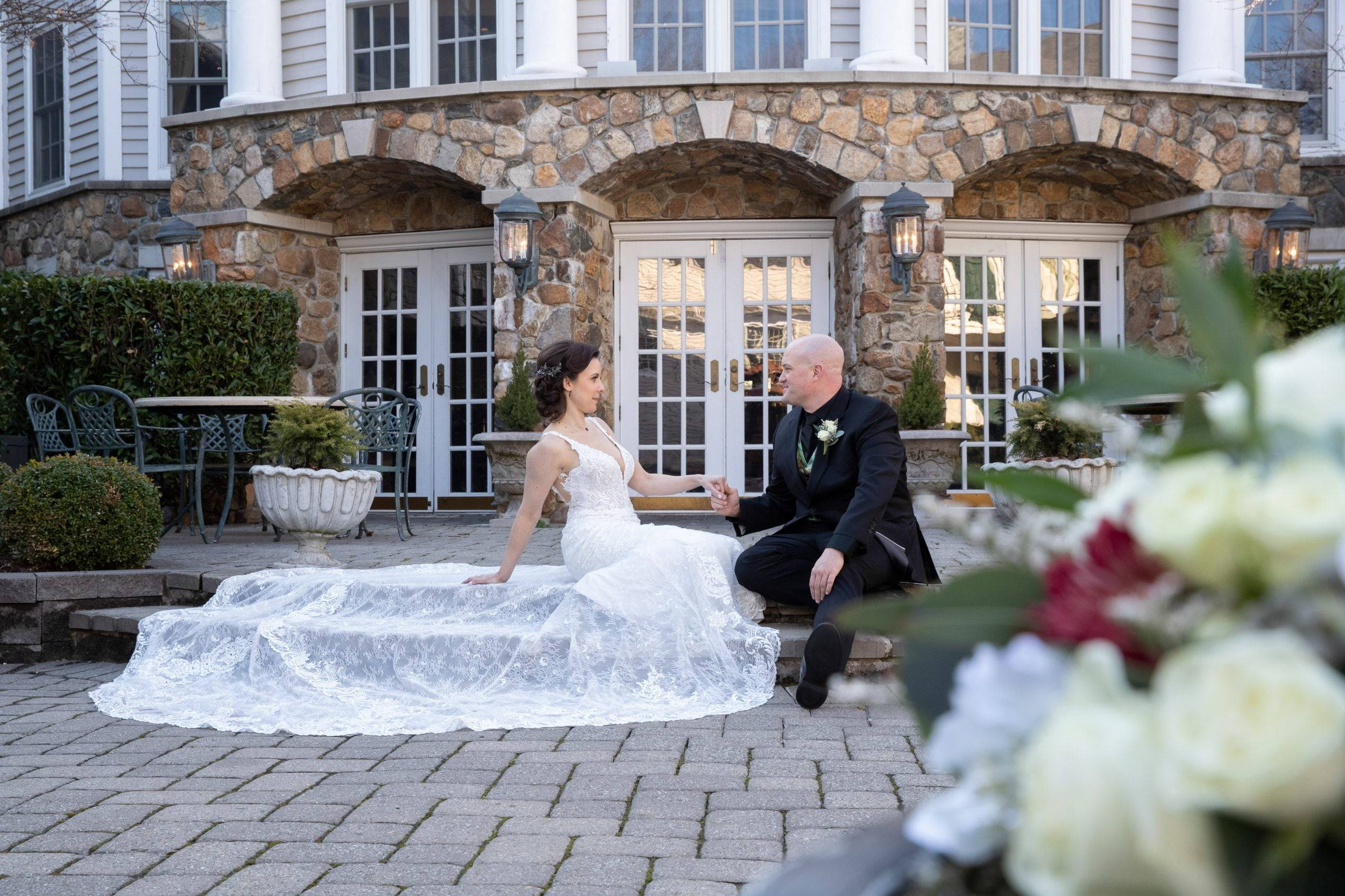Olde Mill Inn bride and groom sitting on patio
