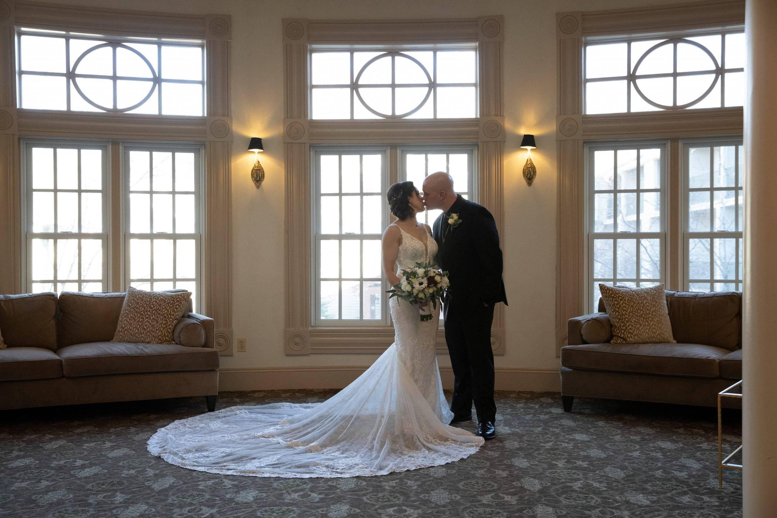 Olde Mill Inn bride and groom kiss in salon