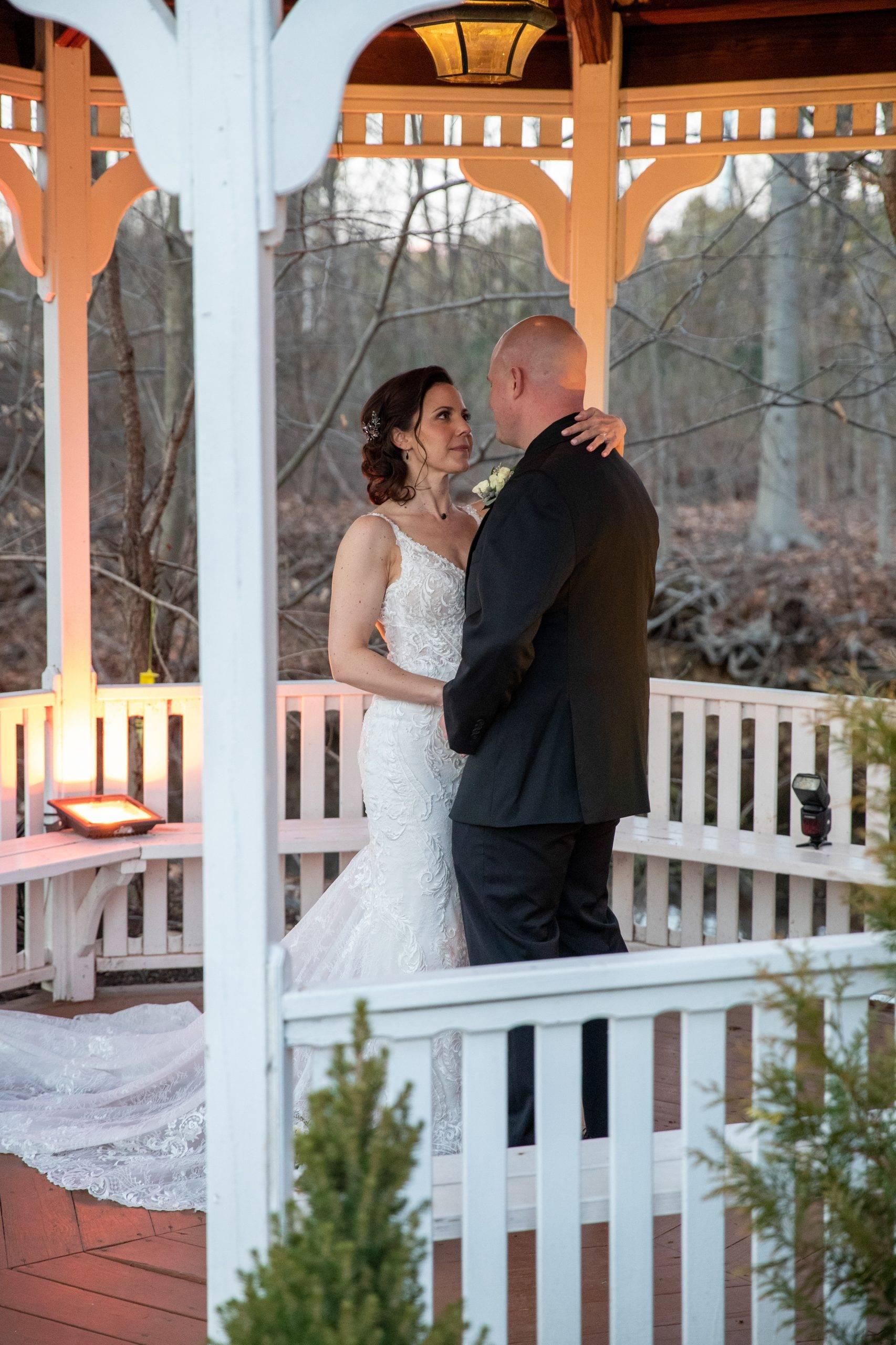 Olde Mill Inn bride and groom in gazebo