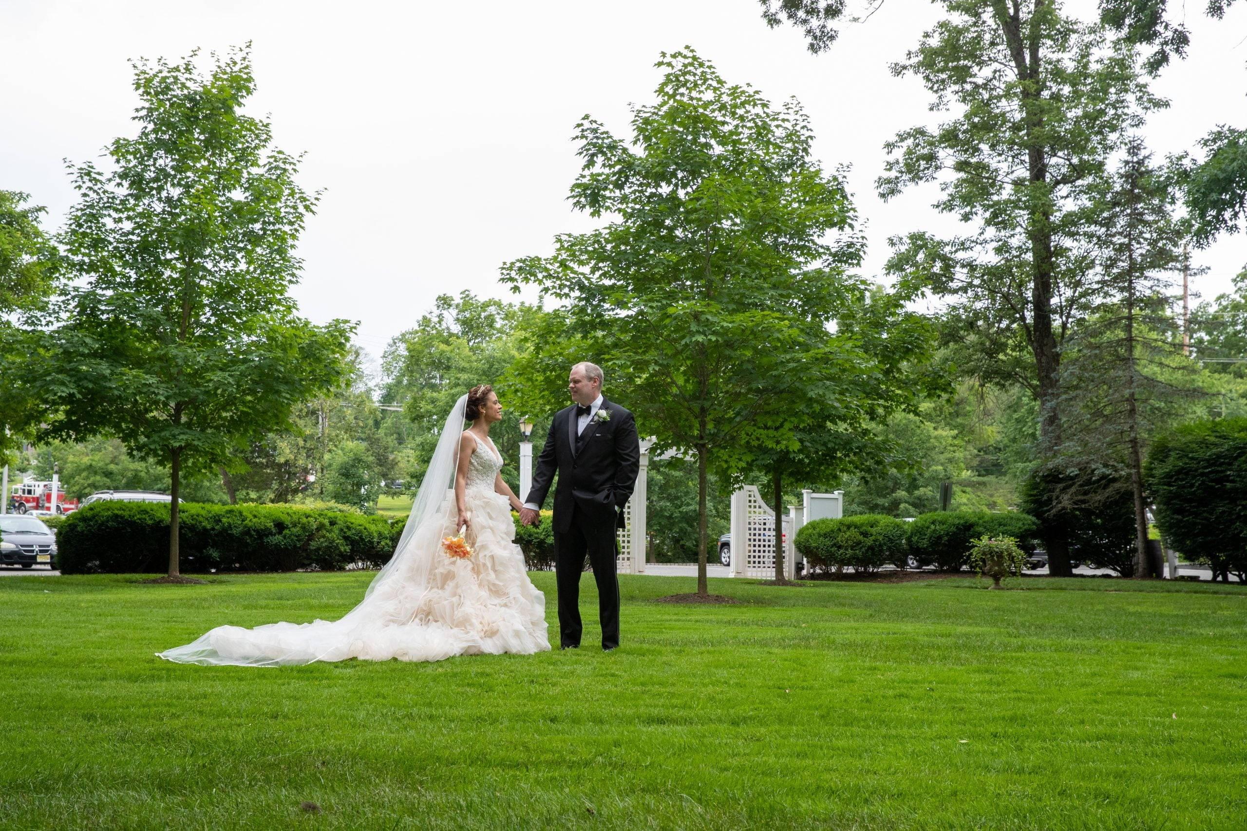 Olde Mill Inn wedding couple on the grass