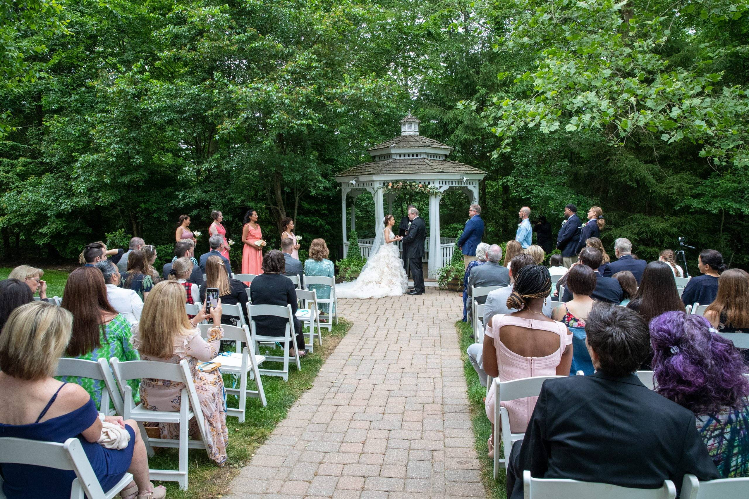 Olde Mill Inn wedding ceremony by gazebo