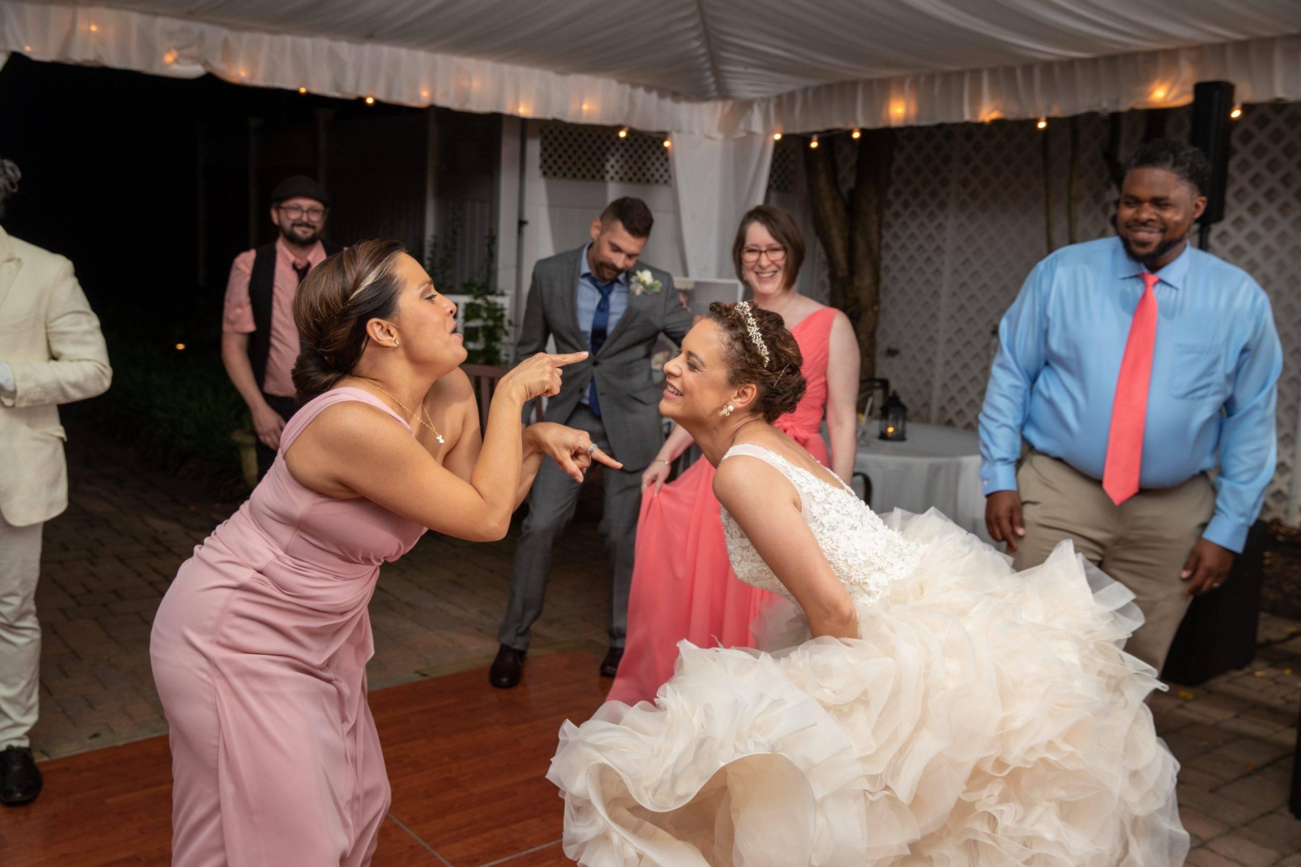 Olde Mill Inn bride and bridesmaid dancing at reception