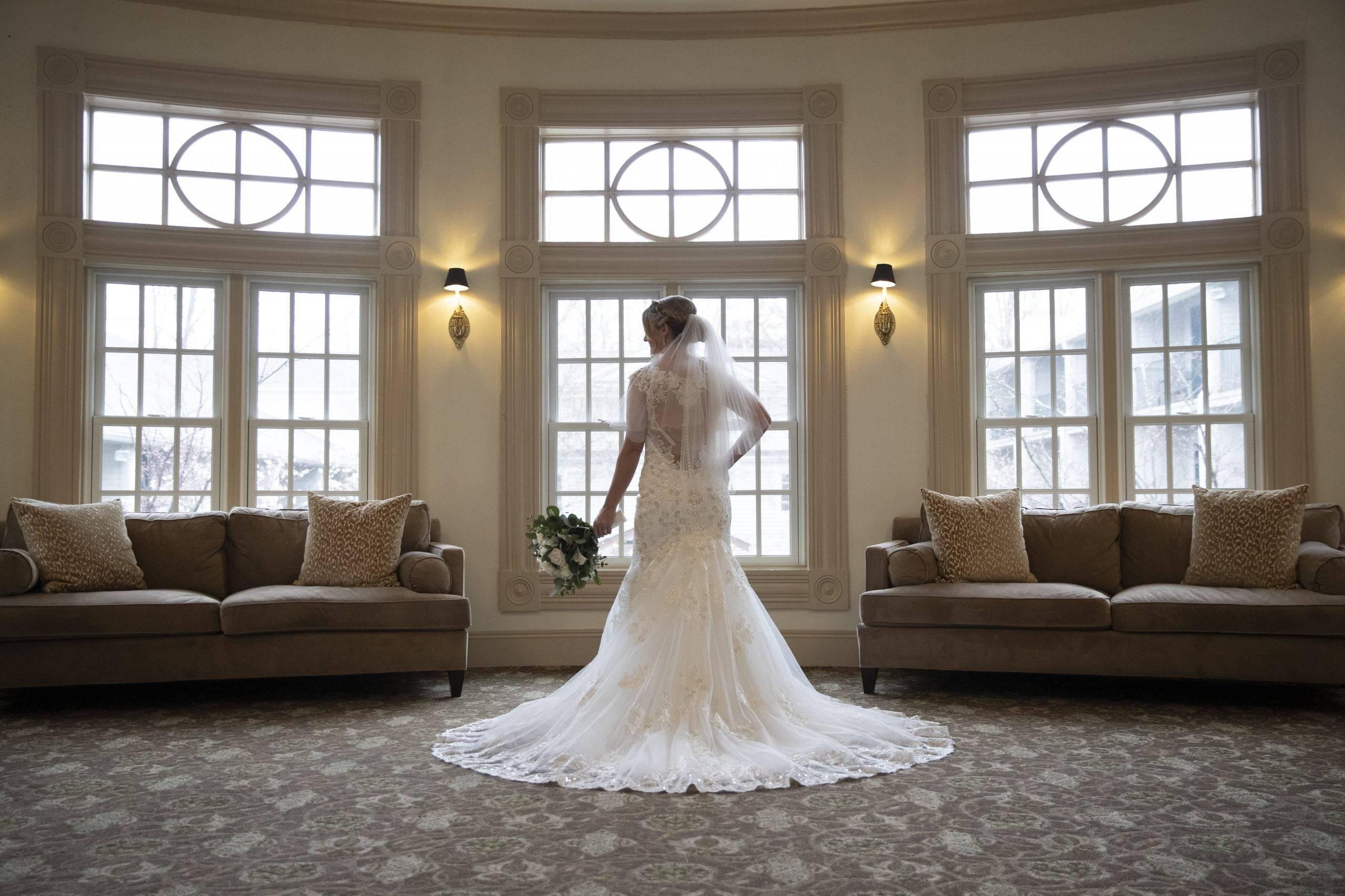 Olde Mill Inn bride in front of windows
