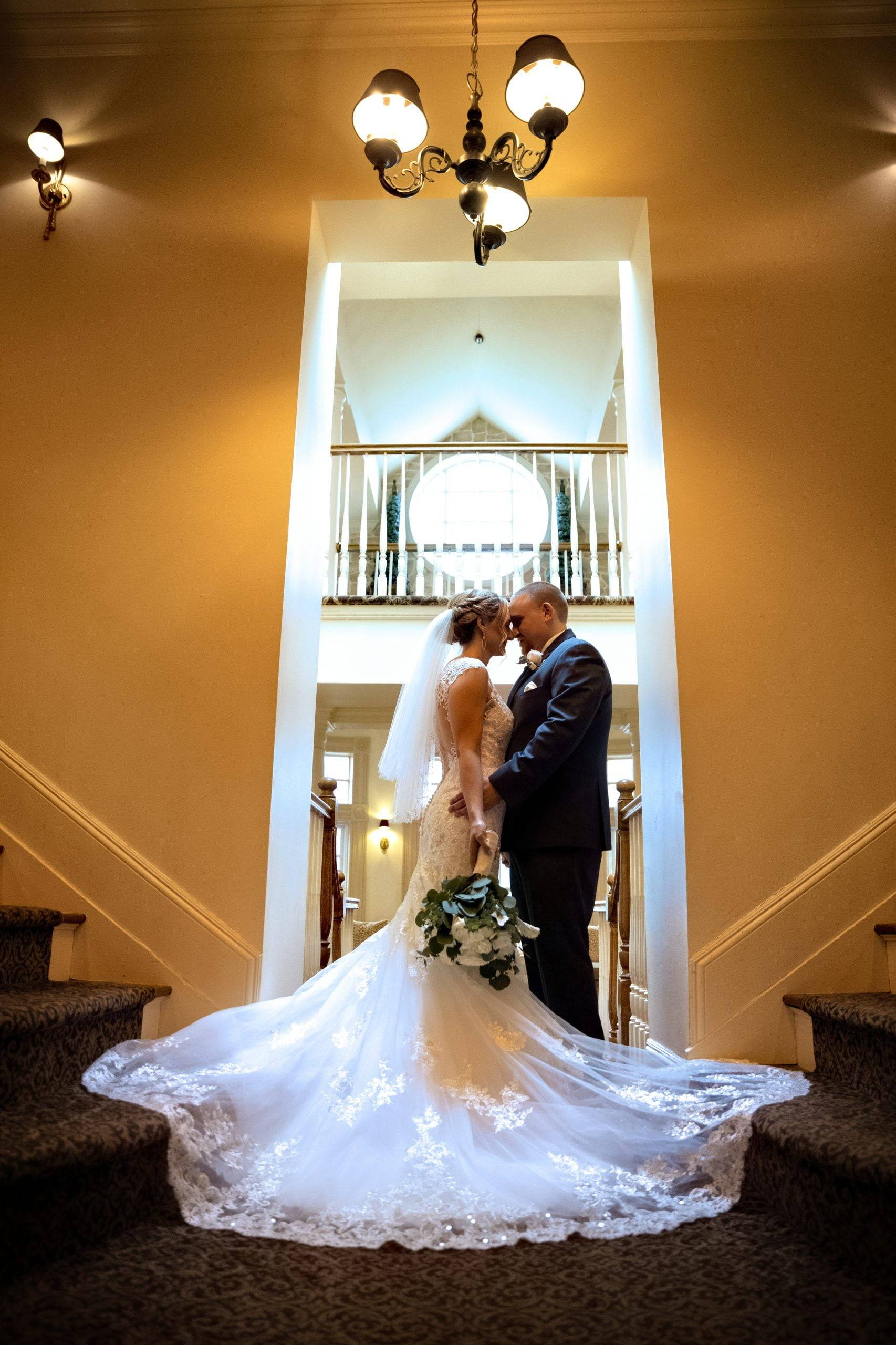 Olde Mill Inn bride and groom by staircases