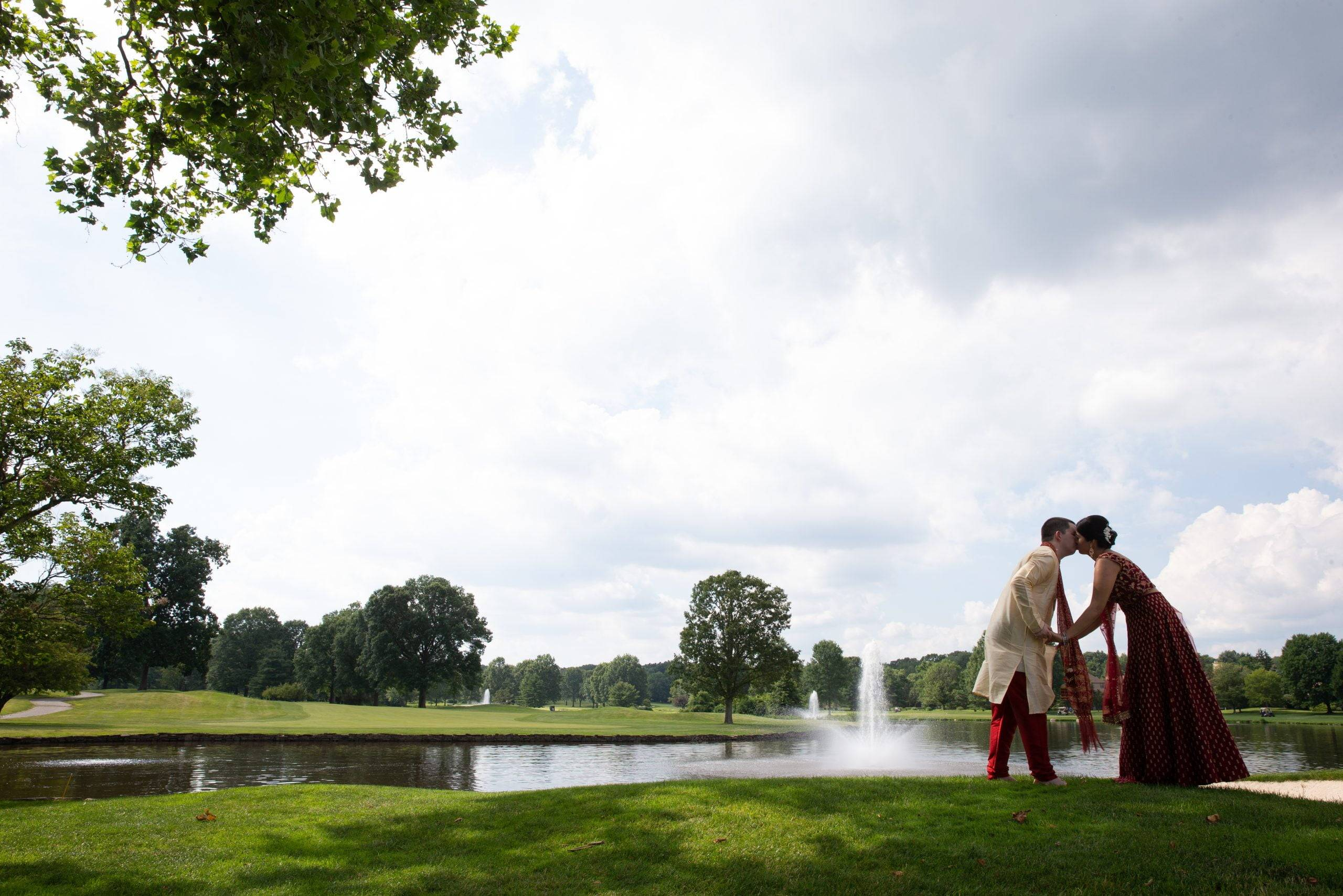 Brooklake Indian bride and groom kiss by the lake