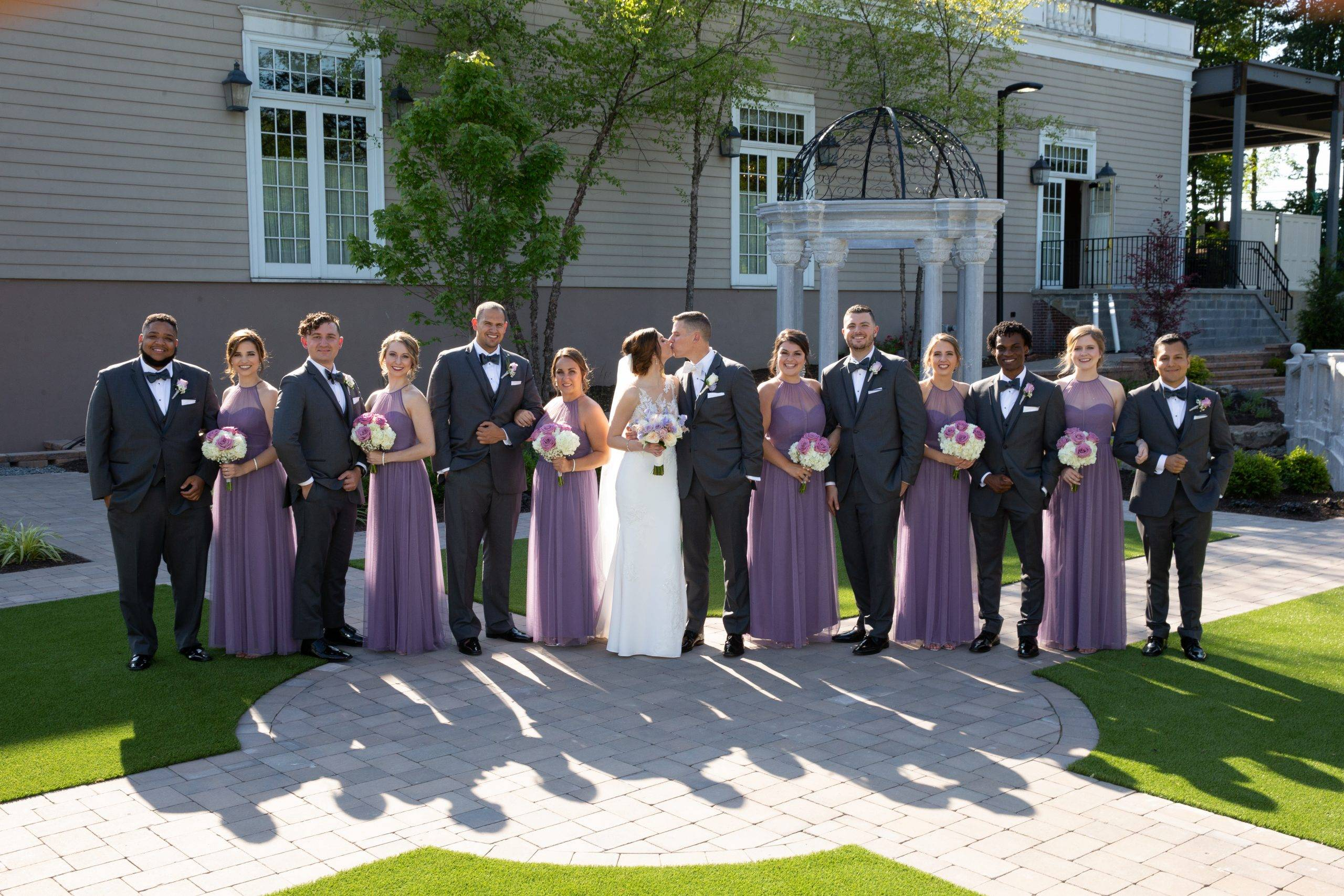 Meadow Wood wedding party with a kiss