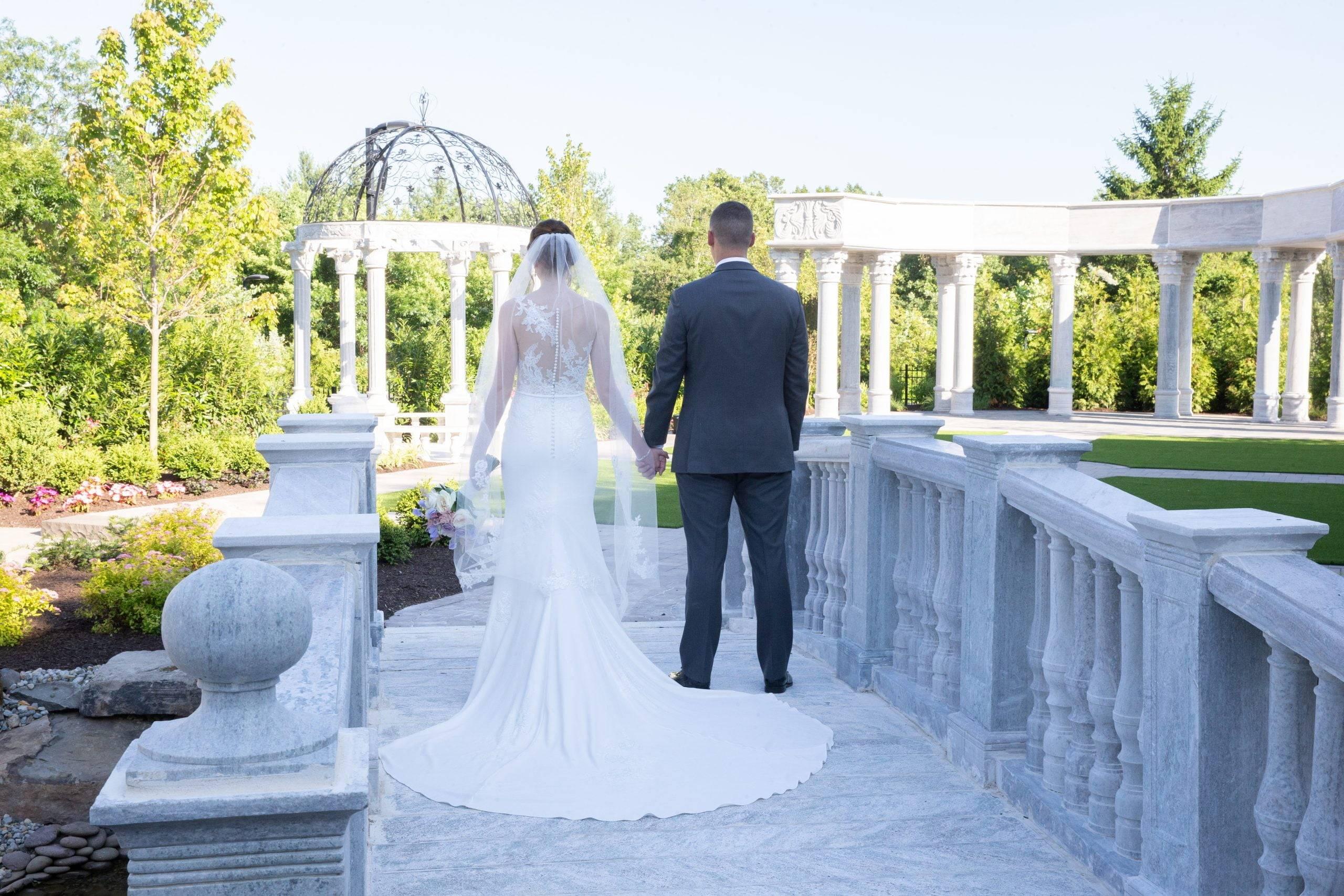 Meadow Wood bride and groom walking on outdoor patio