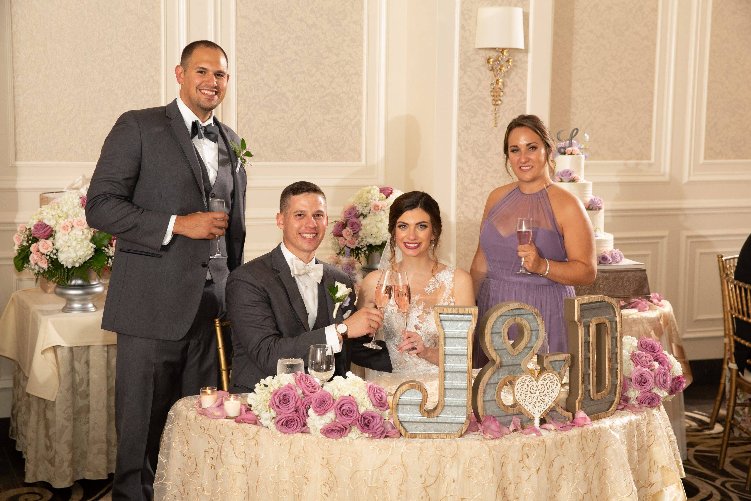 Meadow Wood wedding couple with best man and maid of honor