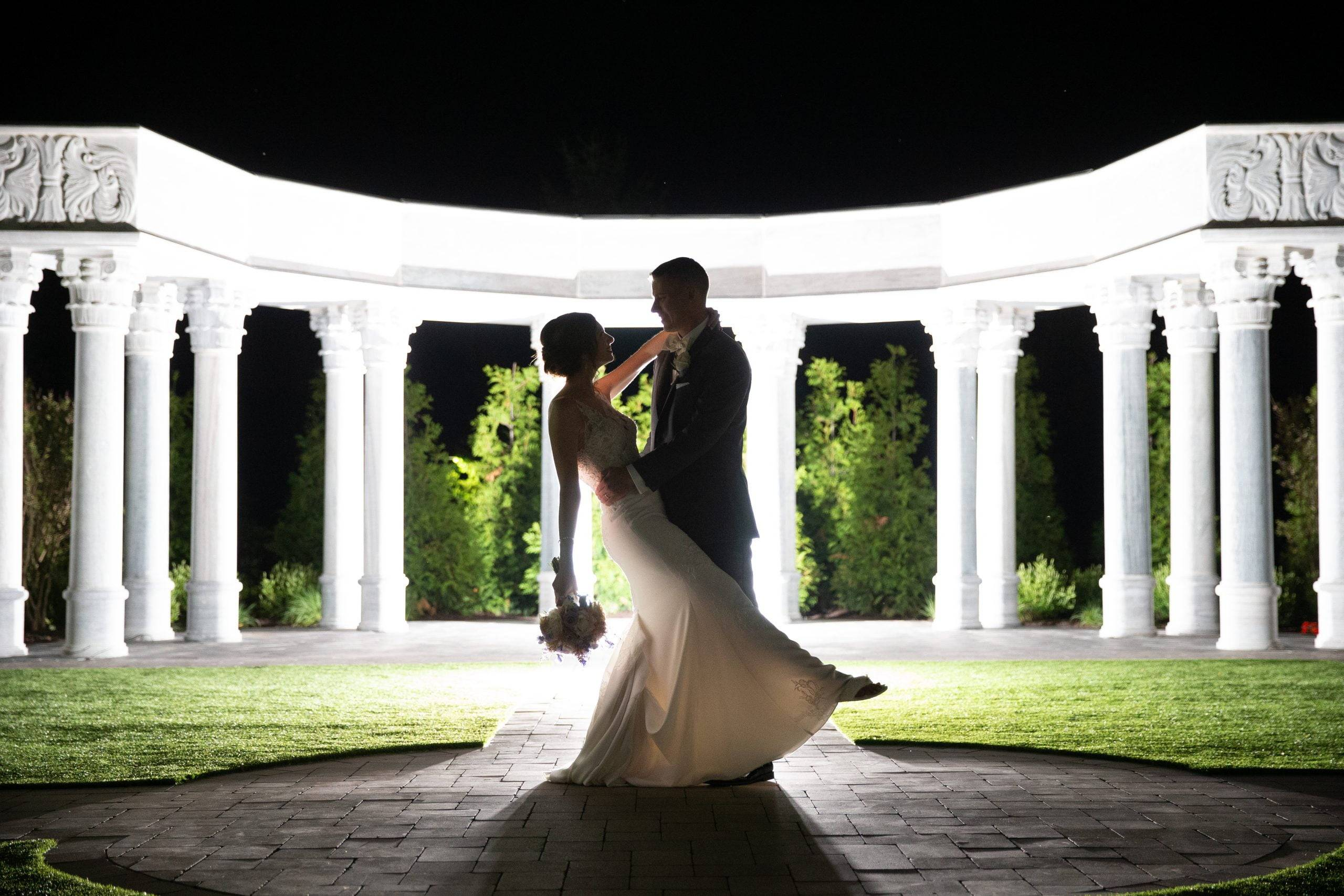 Meadow Wood nighttime wedding couple dance outside