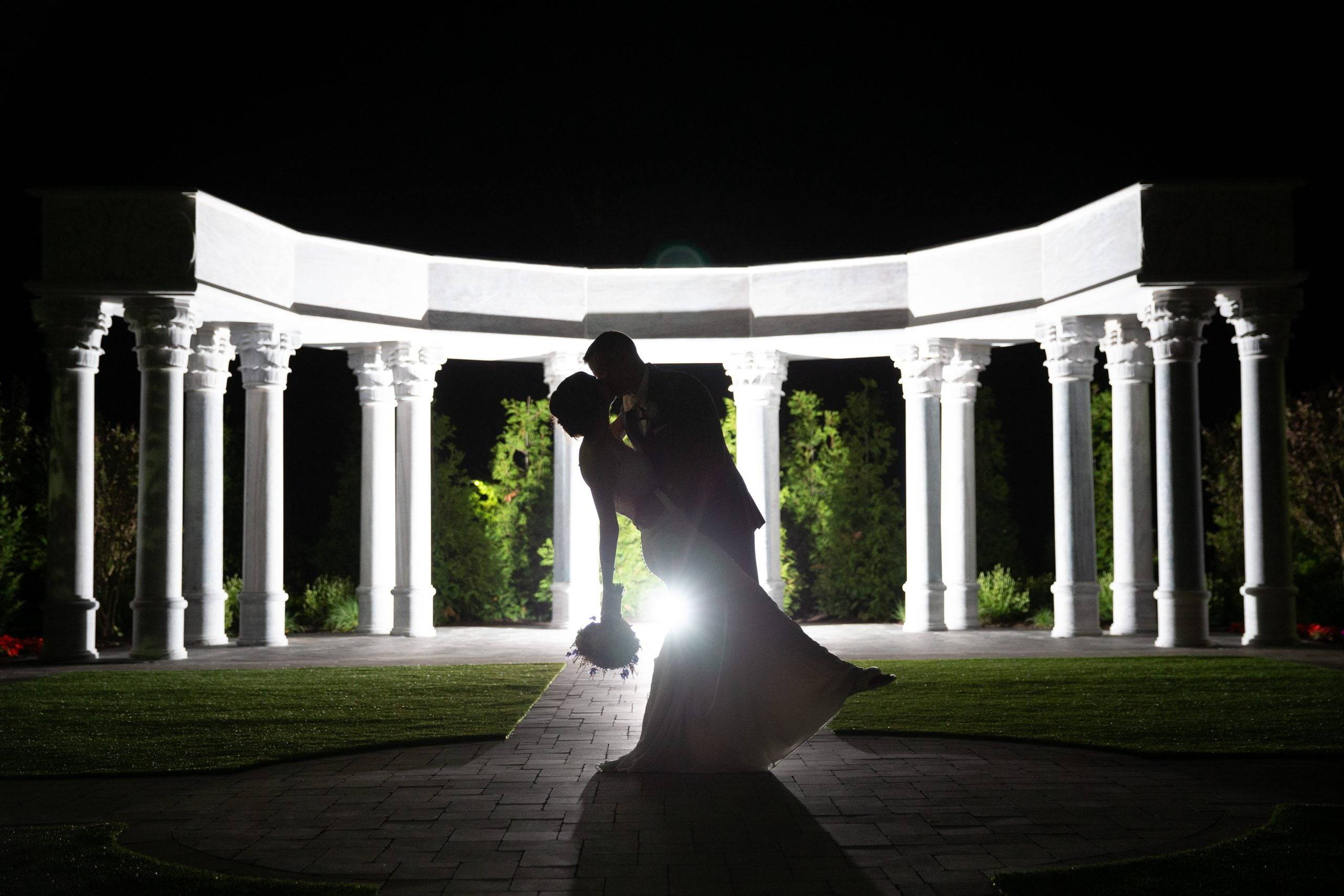 Meadow Wood nighttime bride and groom kiss