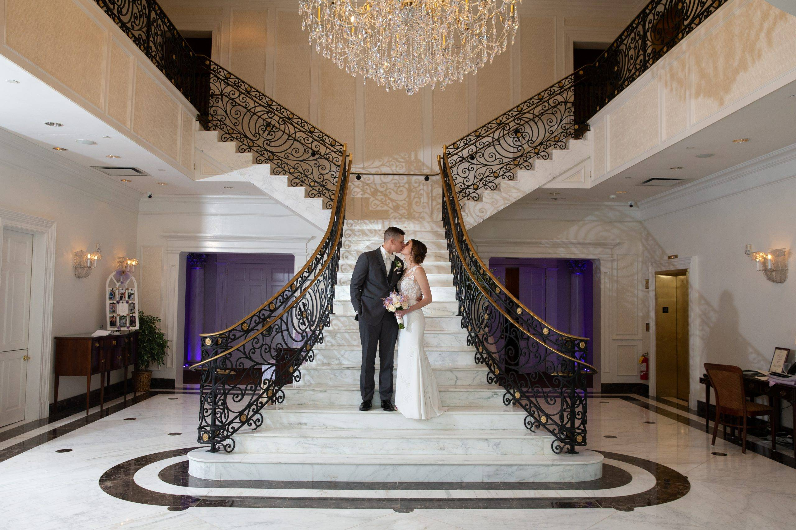 Meadow Wood wedding couple sneak a kiss on staircase