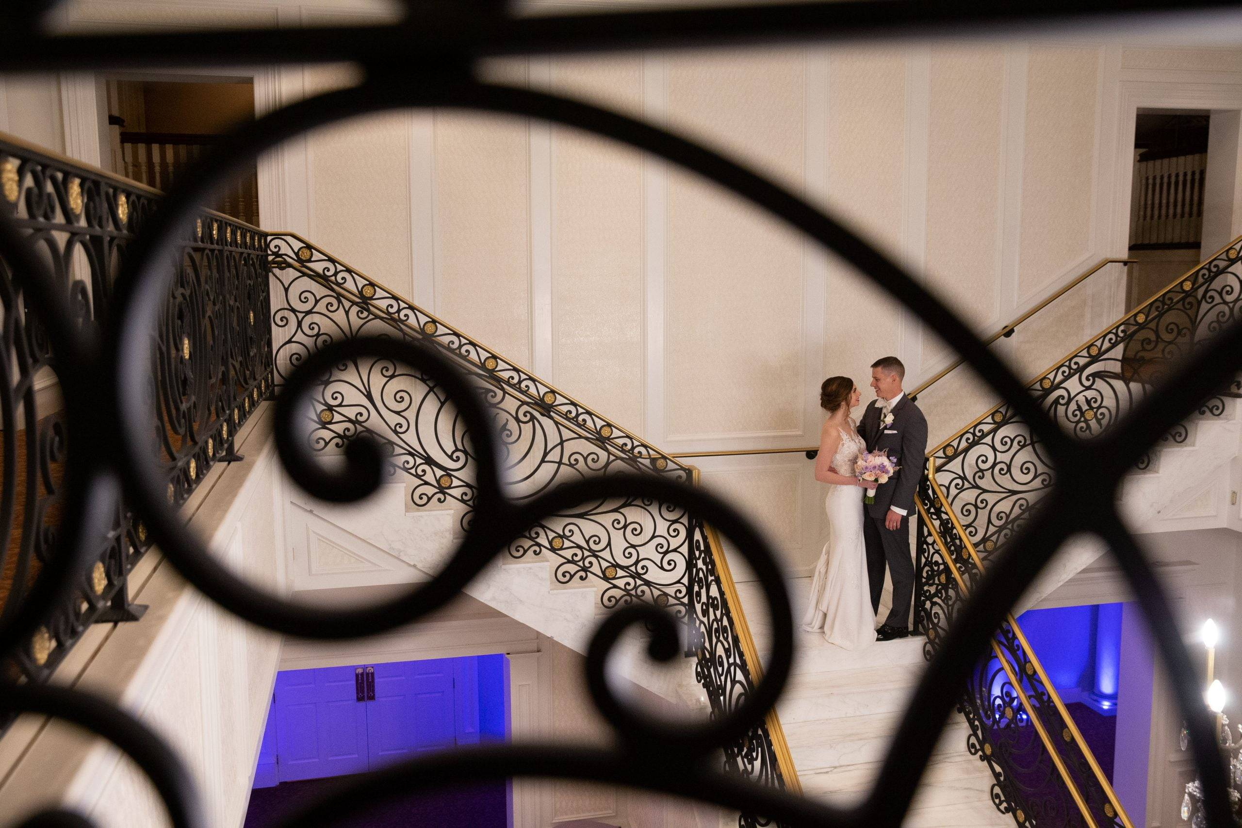 Meadow Wood bride and groom on staircase from above