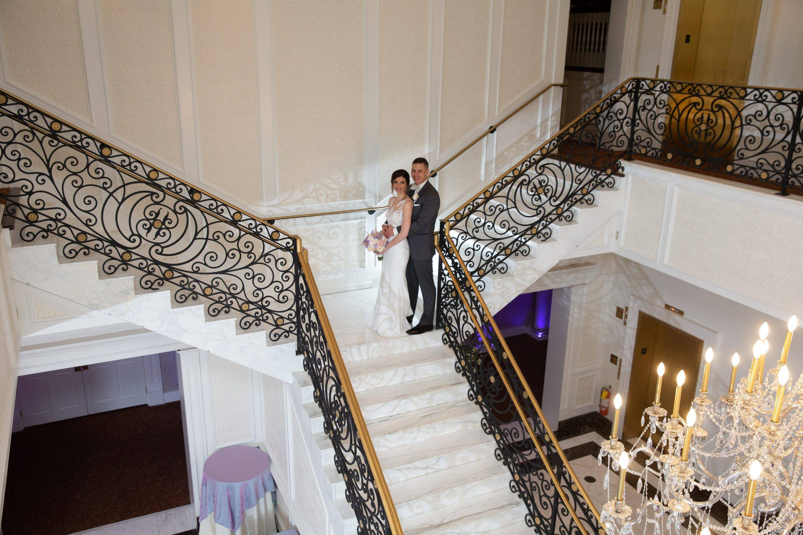 Meadow Wood wedding couple on staircase from above